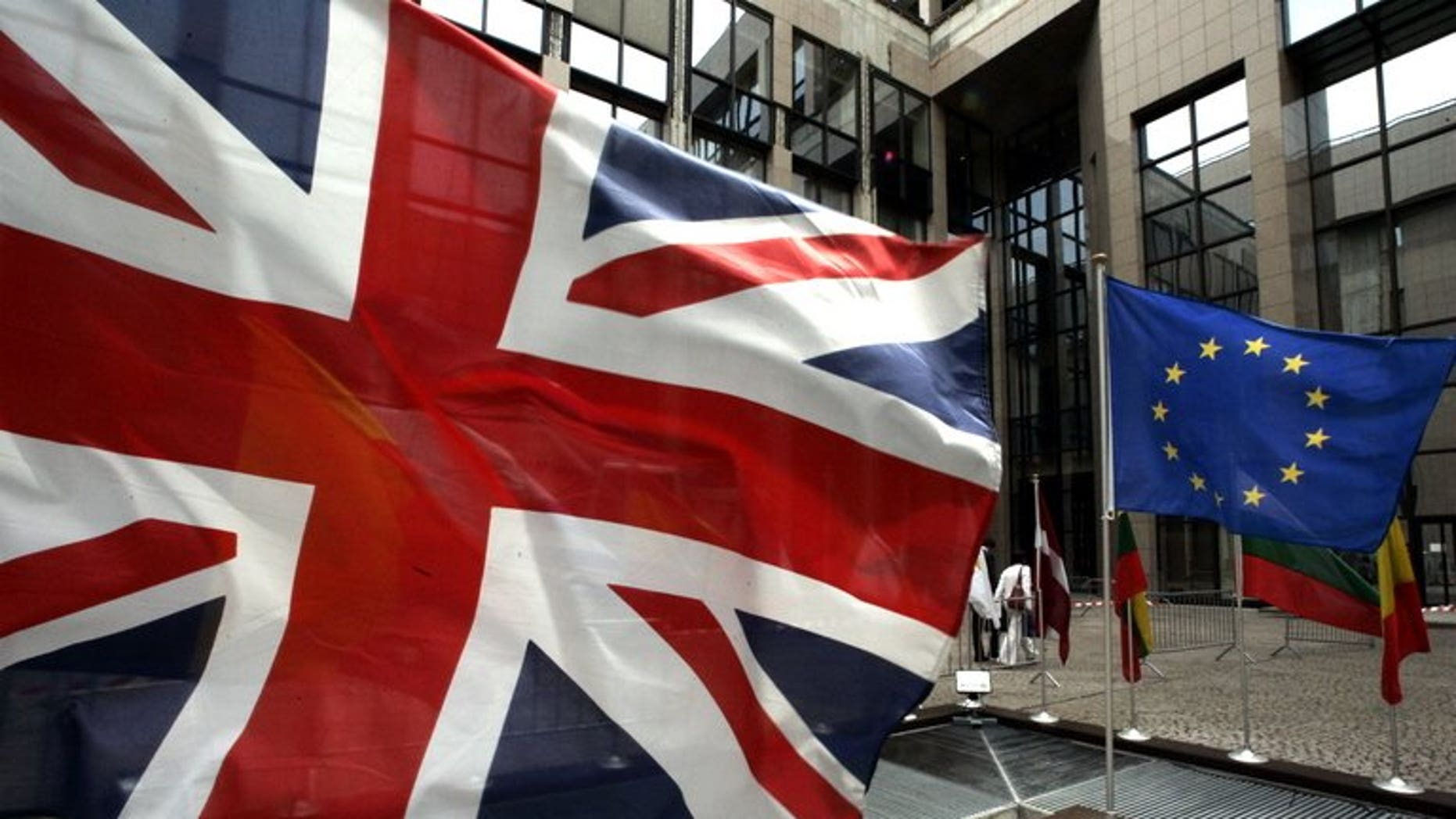 A European Flag and the Union Jack are seen in front of the EU headquarters building in Brussels in 2005. A British think-tank has launched a competition for the best plan to leave the EU -- offering a prize of 100,000 euros ($131,000) instead of in pounds.