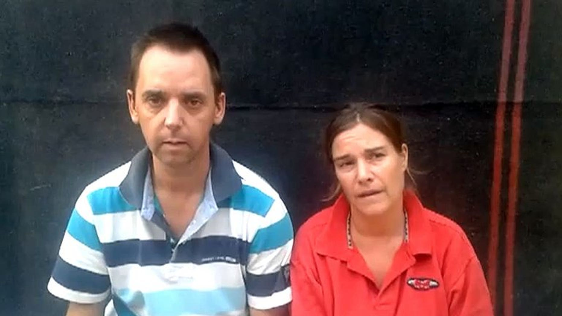 An image grabbed from a video dated July 13, 2013 and posted on YouTube and Facebook on July 16, 2013 shows Dutch nationals Judith Spiegel and her partner Boudewijn Berendsen speaking at an undisclosed location.