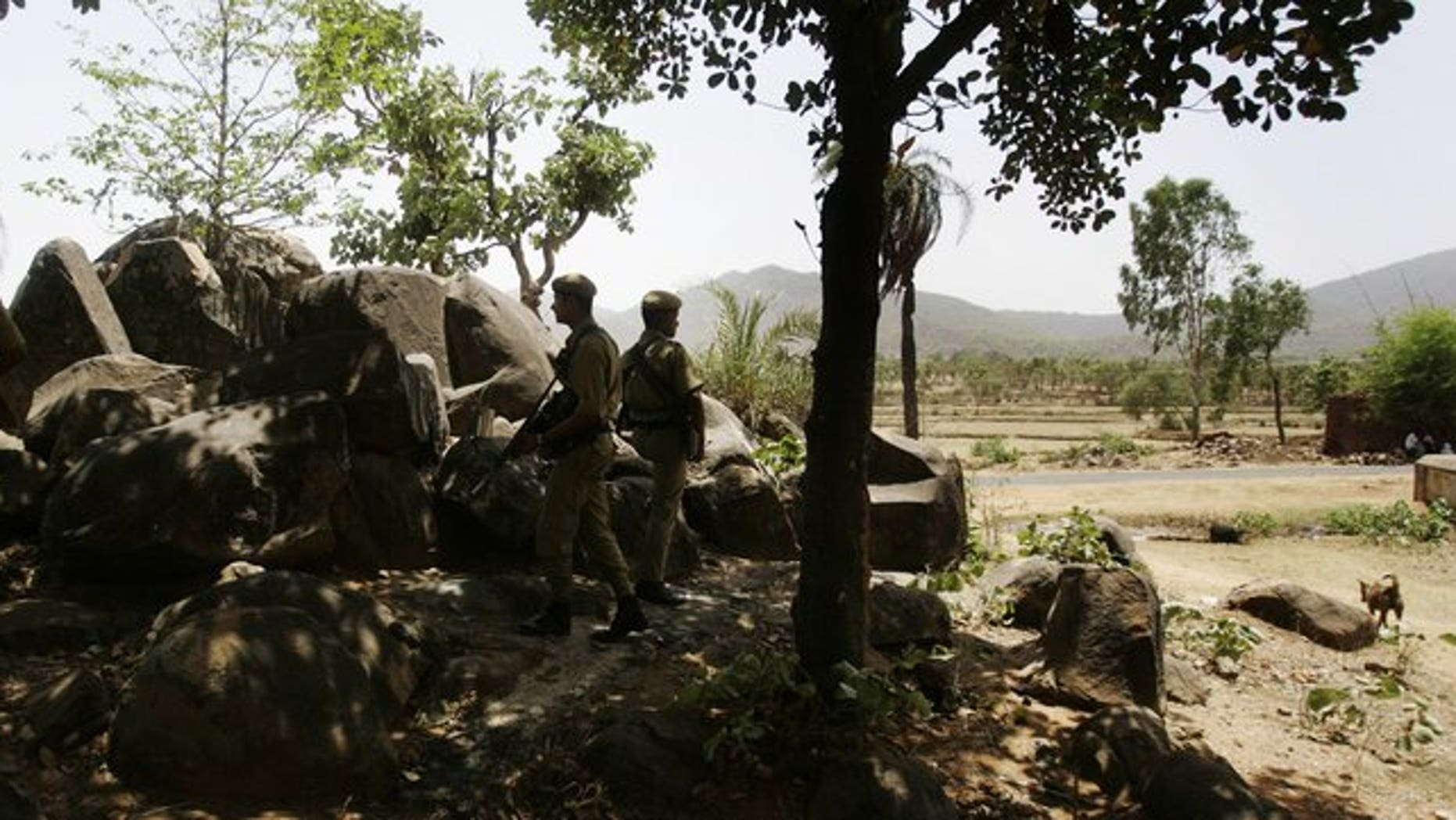 Indian security men take up position in the state of Jharkhand, on April 23, 2009. Indian police arrested eight suspects on Tuesday over the gang-rape of four schoolgirls abducted from their convent boarding house in the country's east, officials said.