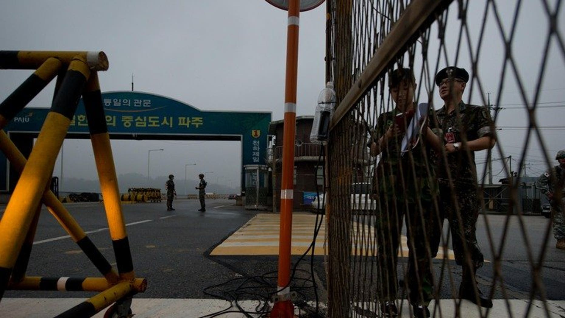 South Korean soldiers stand at a military checkpoint leading to North Korea's Kaesong joint industrial complex, in the border city of Paju early on July 10, 2013. North and South Korea will hold fresh talks Wednesday on reopening their joint industrial zone as hopes of an early agreement fade following months of friction.