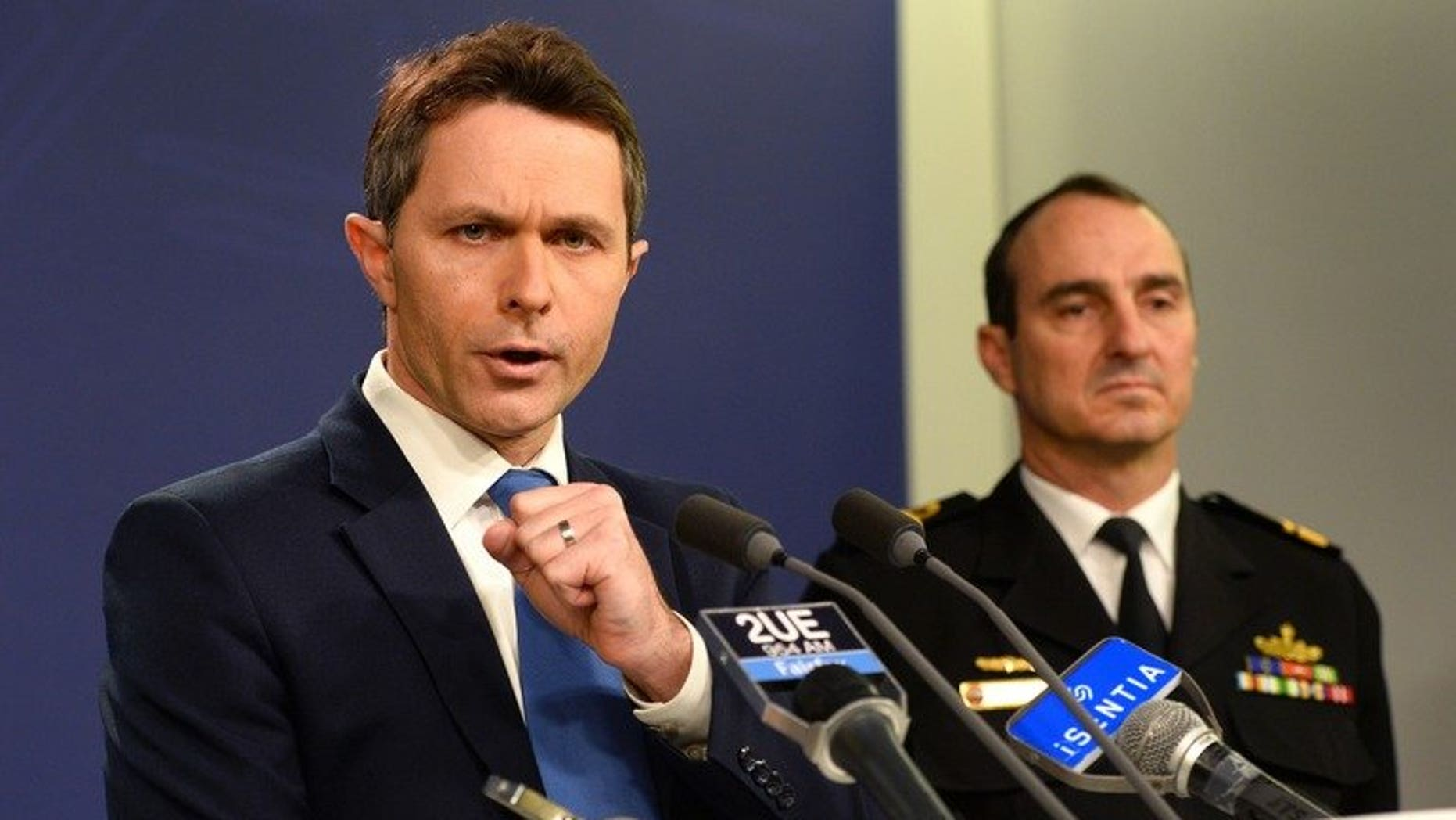 """Australian Home Affairs Minister Jason Clare (L) and Commander of Border Protection Command, Rear Admiral David Johnston, during a press conference in Sydney on July 17, 2013. Asylum-seekers drowning on the treacherous boat journey to Australia presented a """"god-awful"""" problem, Clare said."""