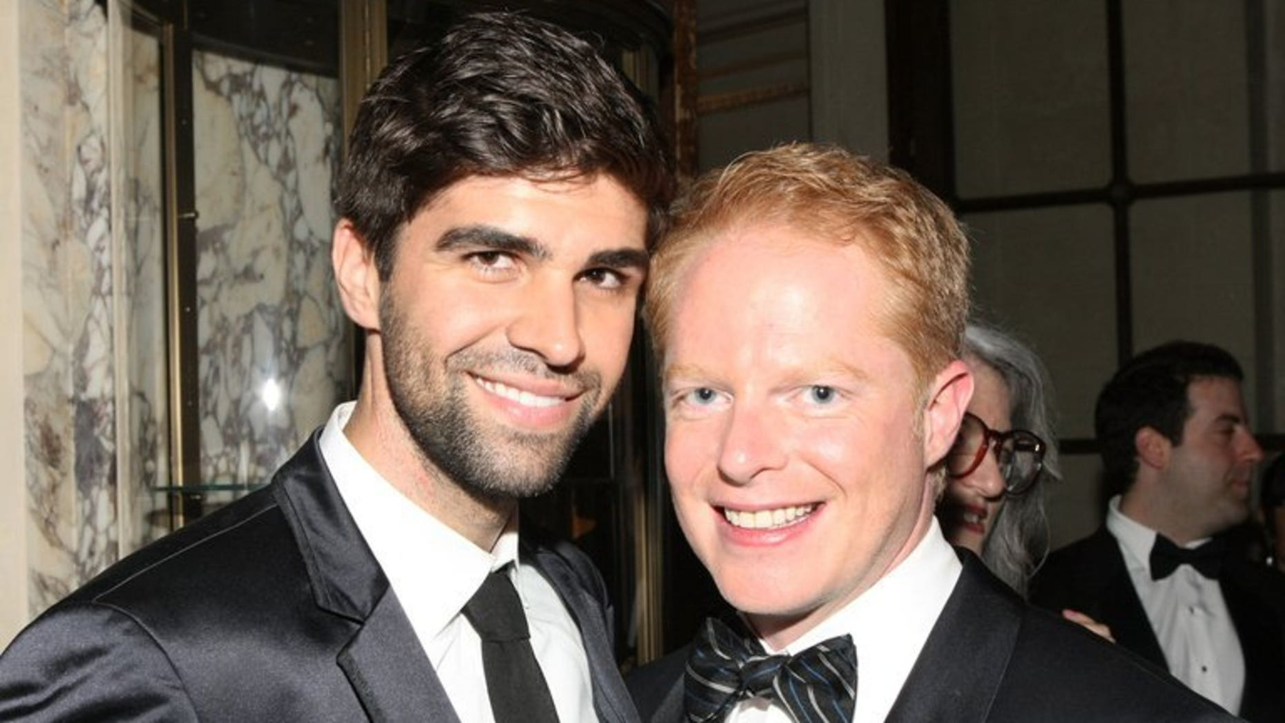 Actor Jesse Tyler Ferguson (R) and his partner Justin Mikita attend the Tony Awards on June 9, 2013 in New York. The pair will attend New Zealand's first same-sex marriage, set to take place on a plane at 30,000 feet (9,150 metres).