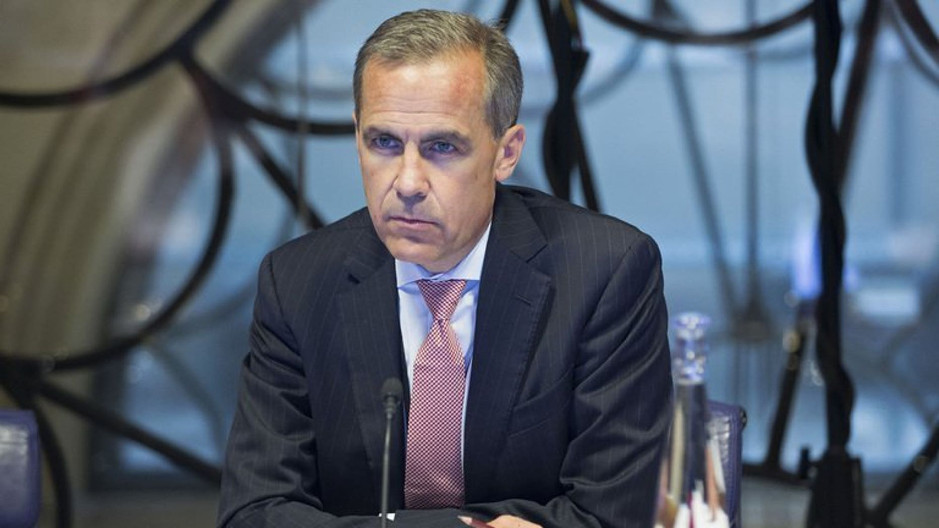 Mark Carney, new governor of the Bank of England, attends a monetary policy committee in London on July 1, 2013. Bank of England policymakers voted unanimously to maintain record-low interest rate and maintain stimulus at Carney's first policy meeting, minutes show.