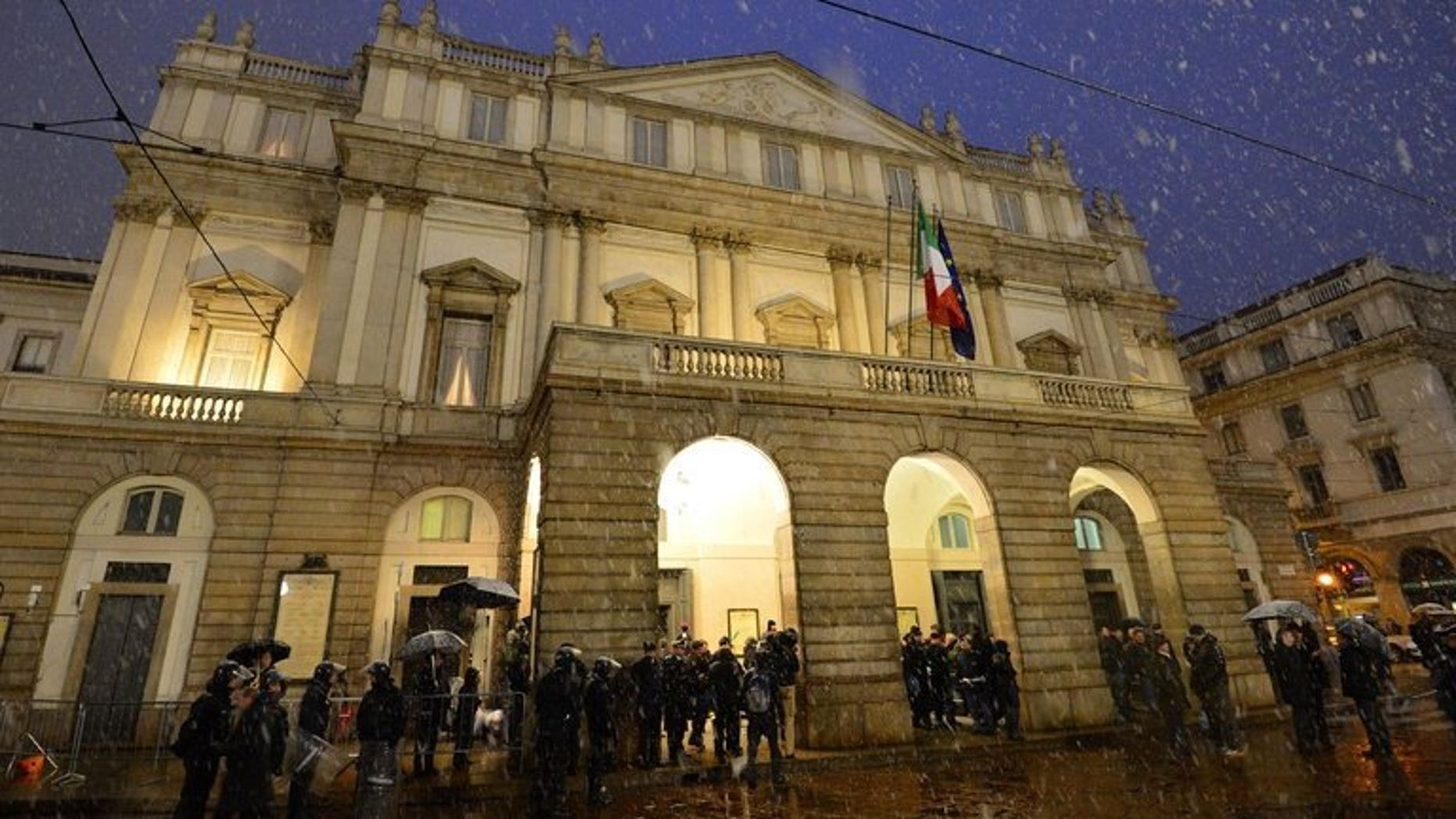 Guests arrive at the entrance of La Scala opera house on December 7, 2012 in Milan. Austrian musical director Alexander Pereira will take over at Italy's prestigious opera house in 2014, a year earlier than expected, the theatre said Wednesday.