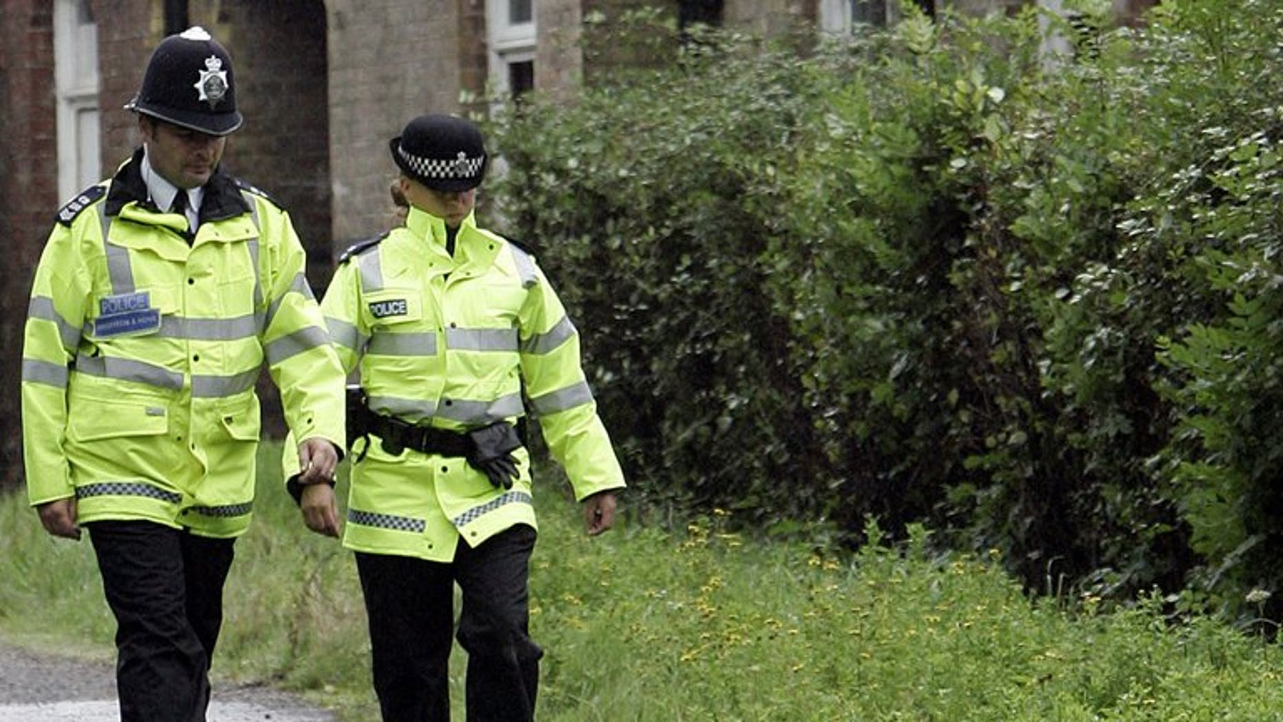 """Police patrol in east Sussex, in southern England, on September 3, 2006. British police on Wednesday said they had found the body of an actor who appeared in James Bond film """"Casino Royal"""", who went missing in London last Wednesday."""