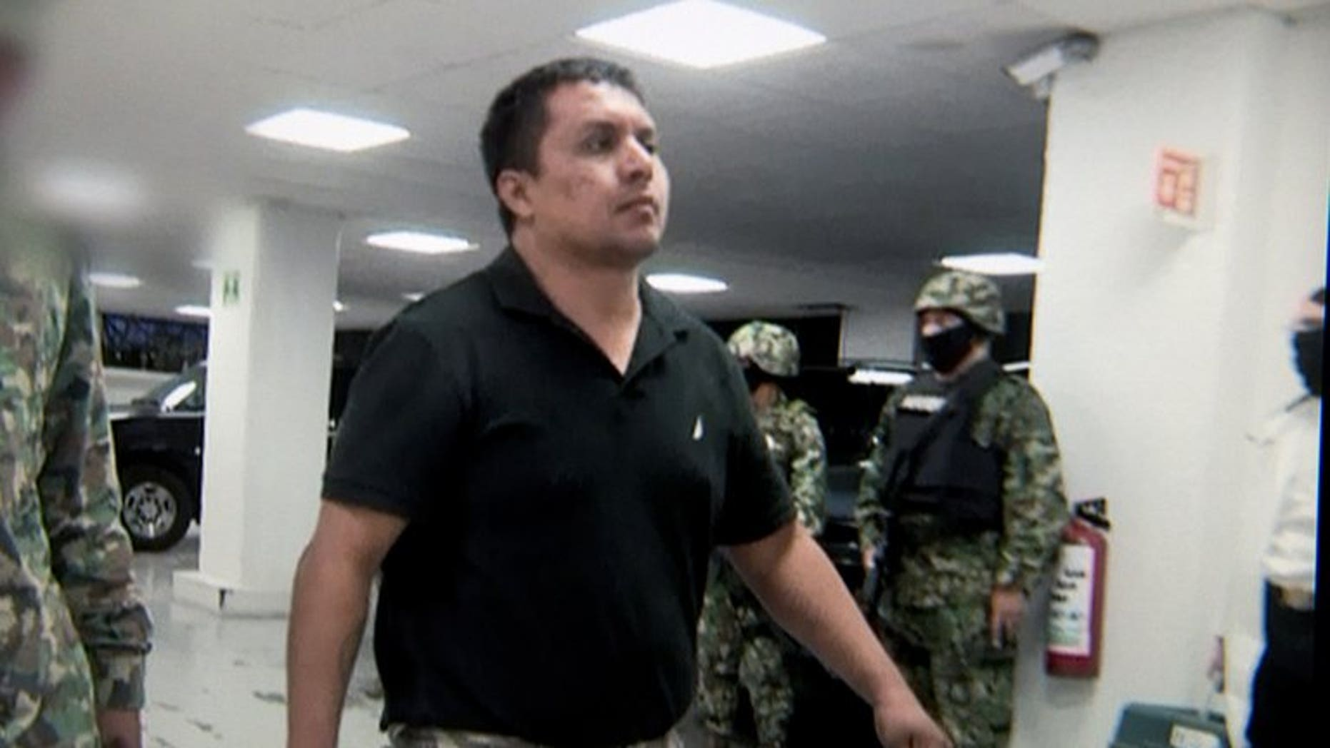 Picture taken from a video released by the Mexican Navy showing the captured head of the Zetas drug cartel Miguel Angel Trevino in Mexico City on July 16, 2013. Trevino has filed for legal protection over claims that he is at risk of torture or isolation during his detention, court officials said.