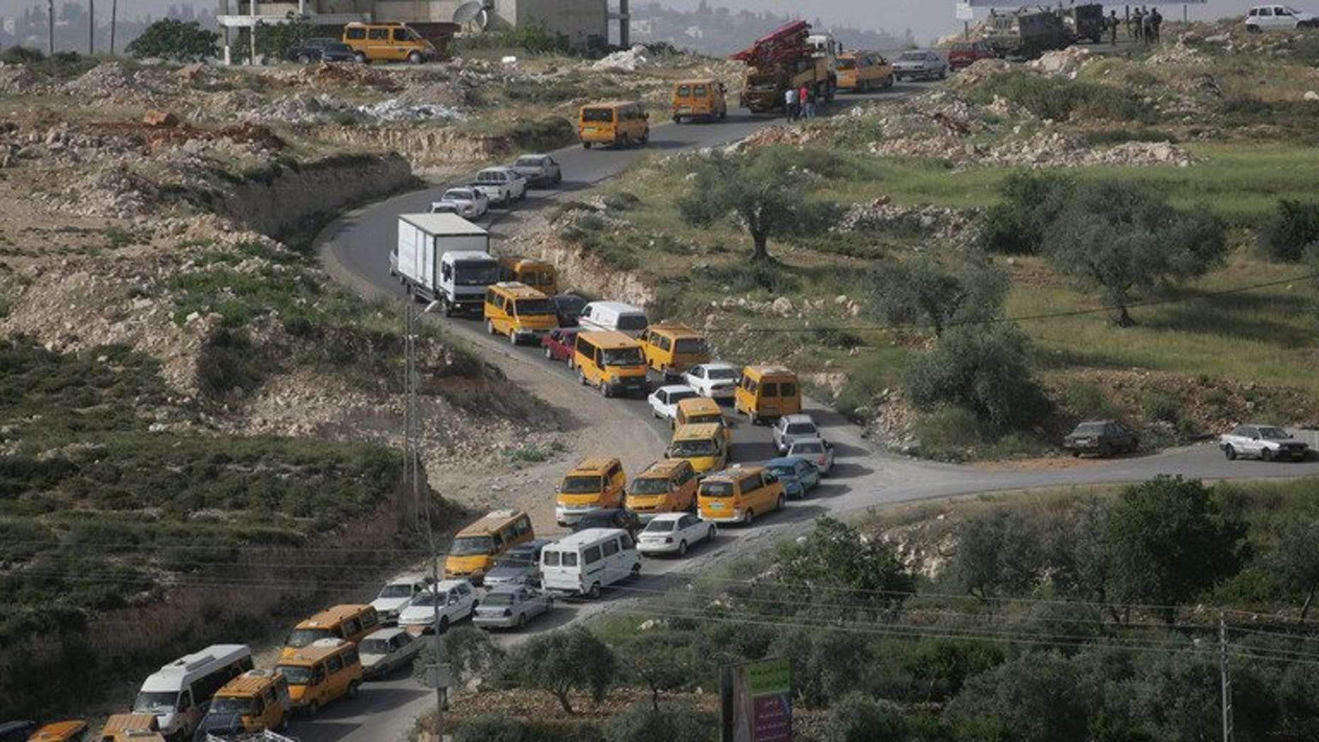Palestinian vehicles are stuck in traffic on the main road linking the West Bank city of Ramallah with the nearby town of al-Bireh after Israeli troops forced hundreds of motorists to queue for ID checks on April 23, 2008. The Israeli military is preparing to lift some restrictions on Palestinian movement in advance of possible renewed peace talks, according to army radio.