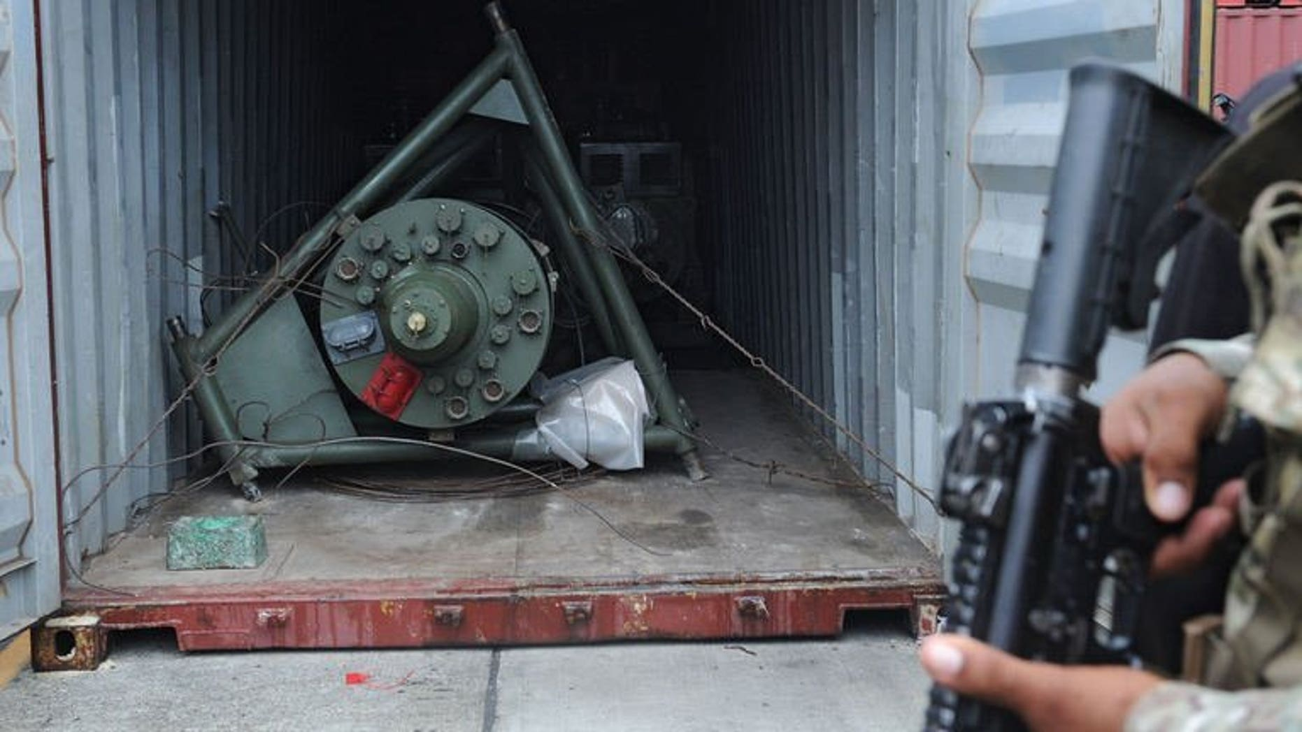 A Panamanian soldier guards a container on the North Korean ship Chong Chon Gang, in which Soviet-era weaponry was found, at Manzanillo Port in Colon, Panama, on July 17, 2013. North Korean sailors whose dilapidated ship was halted near the Panama Canal and found to be carrying the military equipment could face up to six years in jail, a prosecutor has said.
