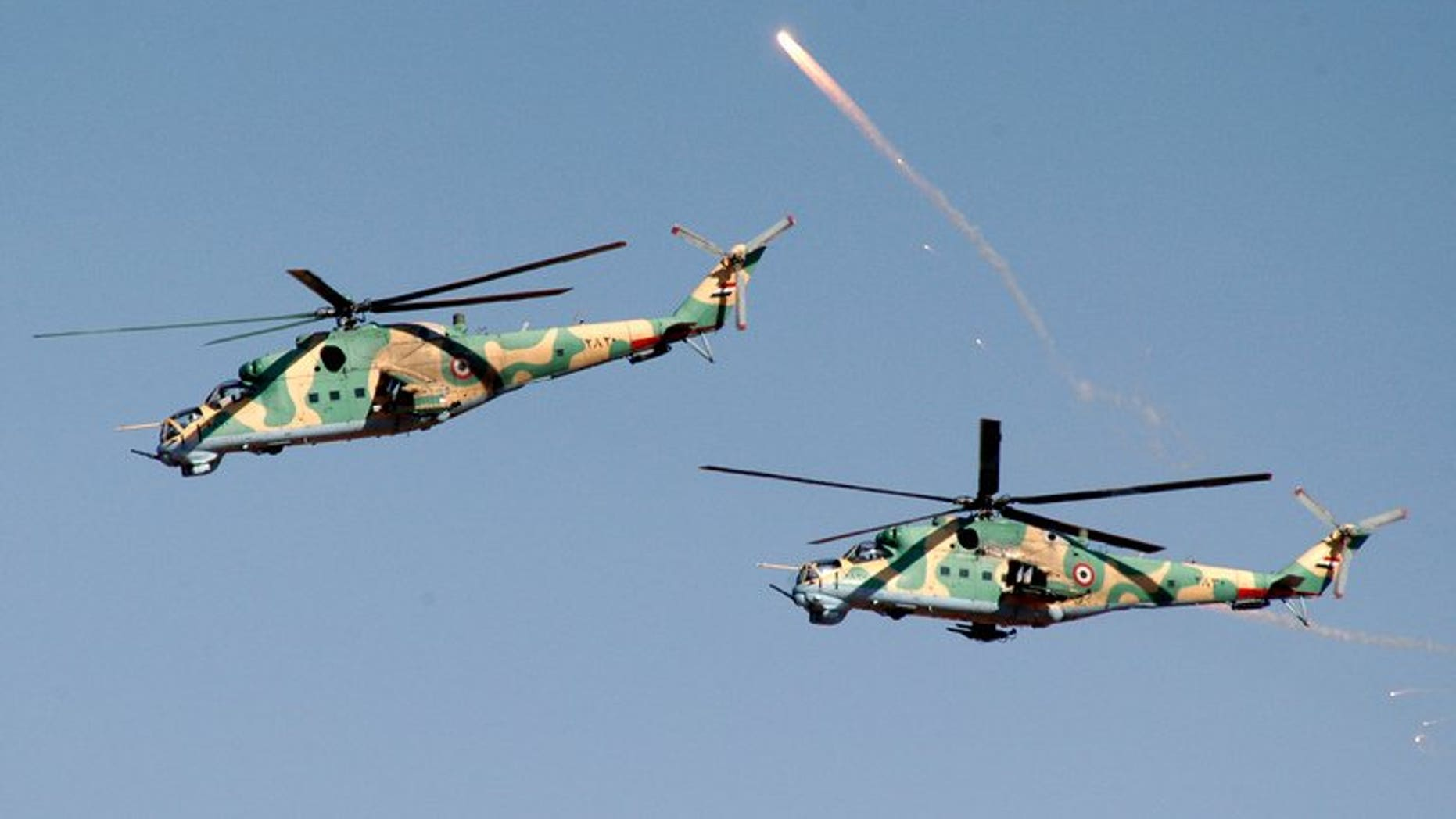 SYrian helicopters take part in military manoeuvres at an undisclosed location on December 20, 2011. A Syrian military helicopter fired rockets at a pro-rebel region of eastern Lebanon in the early hours of Thursday, a security source told AFP.