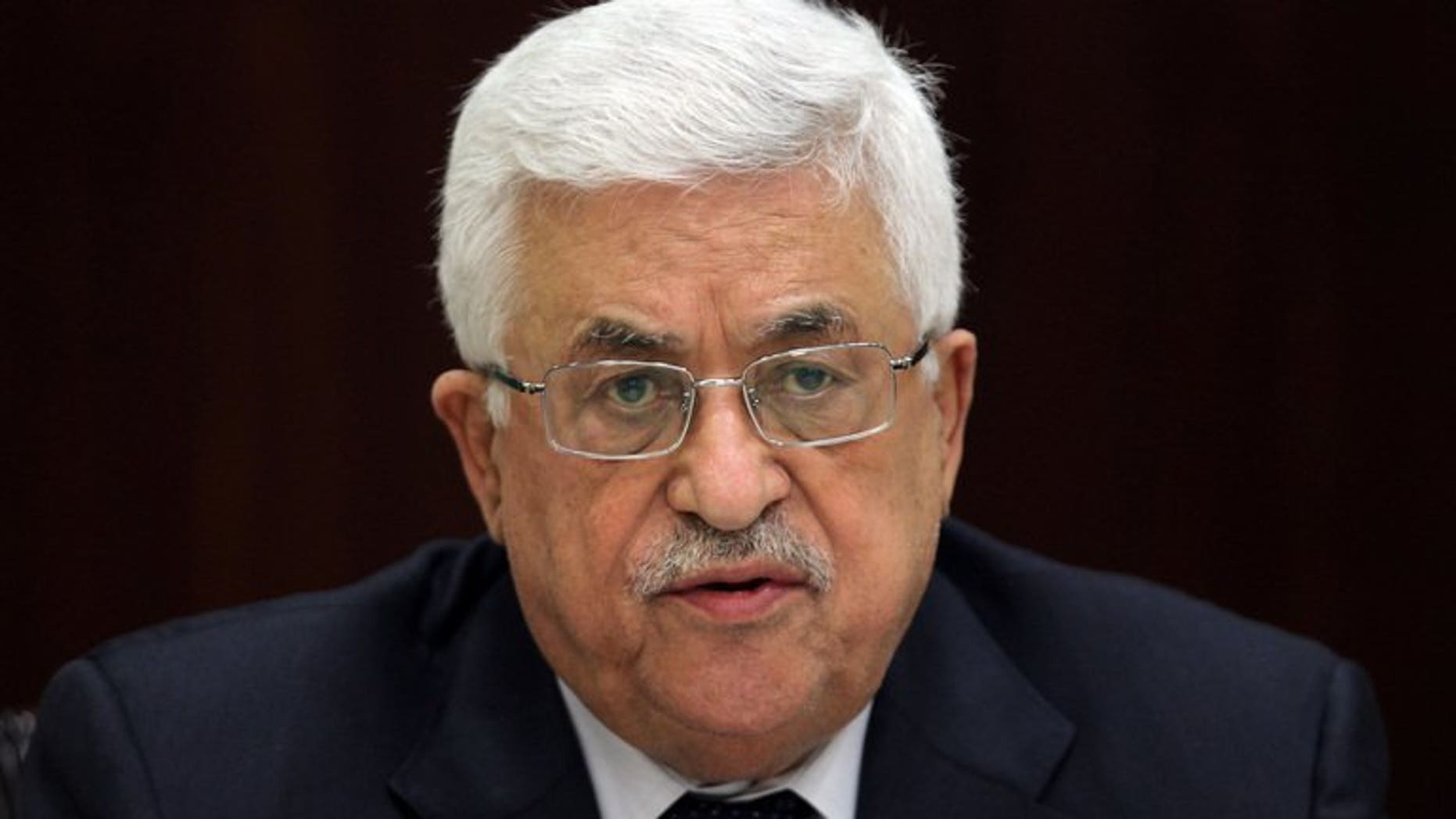 Palestinian president Mahmud Abbas chairs a meeting in Ramallah on May 12, 2013. Palestinian leaders will vote on a US plan under which peace talks with Israel will not depend on a settlement ban, a key Palestinian demand, a PLO official tells AFP.