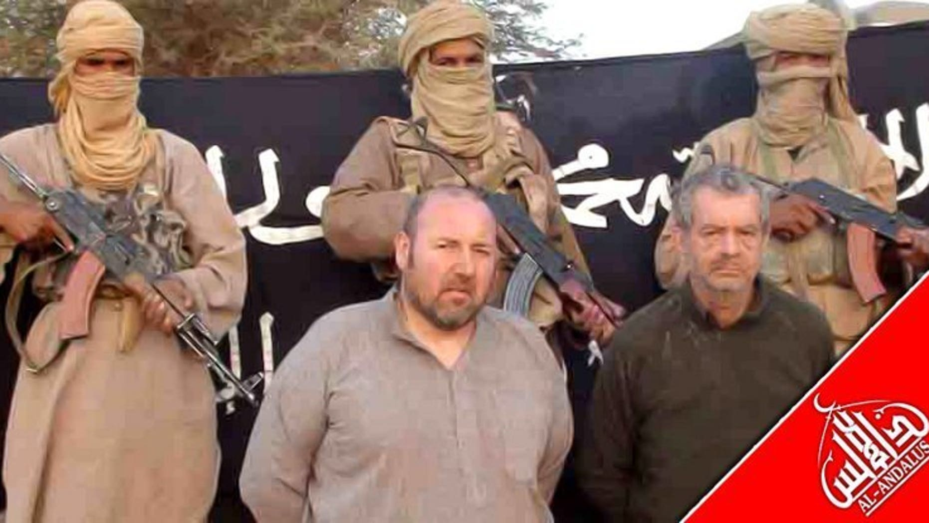 A picture released in December 2011 shows Philippe Verdon (right) and Serge Lazarevic at an undisclosed location. French hostage Verdon, who was kidnapped by Al-Qaeda in the Islamic Maghreb (AQIM) in Mali in 2011 and found dead several weeks ago, was executed with a shot to the head, prosecutors said Thursday