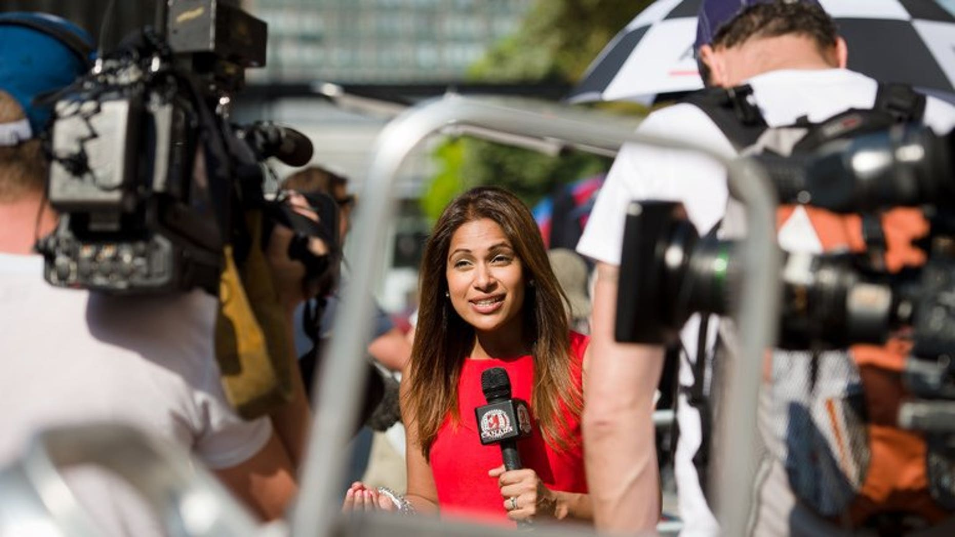 A television presenter records a piece to camera outside the Lindo Wing of St Mary's Hospital in London, on July 17, 2013. After more than two weeks camped outside St Mary's Hospital in London, the media waiting for Prince William's wife Catherine to give birth are having terrible thoughts -- what if they are in the wrong place?