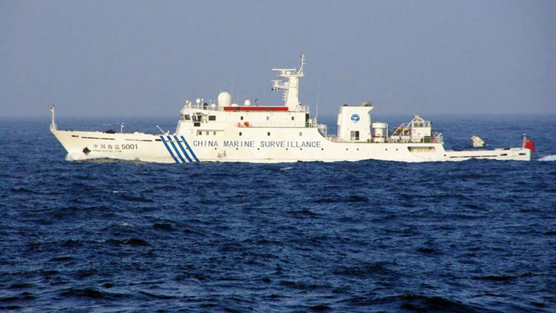 This handout picture taken by the Japan Coast Guard on June 27, 2013 shows a Chinese marine surveillance ship cruising near the disputed islets in the East China Sea. Three Chinese government ships sailed into waters around islands at the centre of a territorial dispute on Thursday, the day after Japan's premier visited coastguards who patrol the area.
