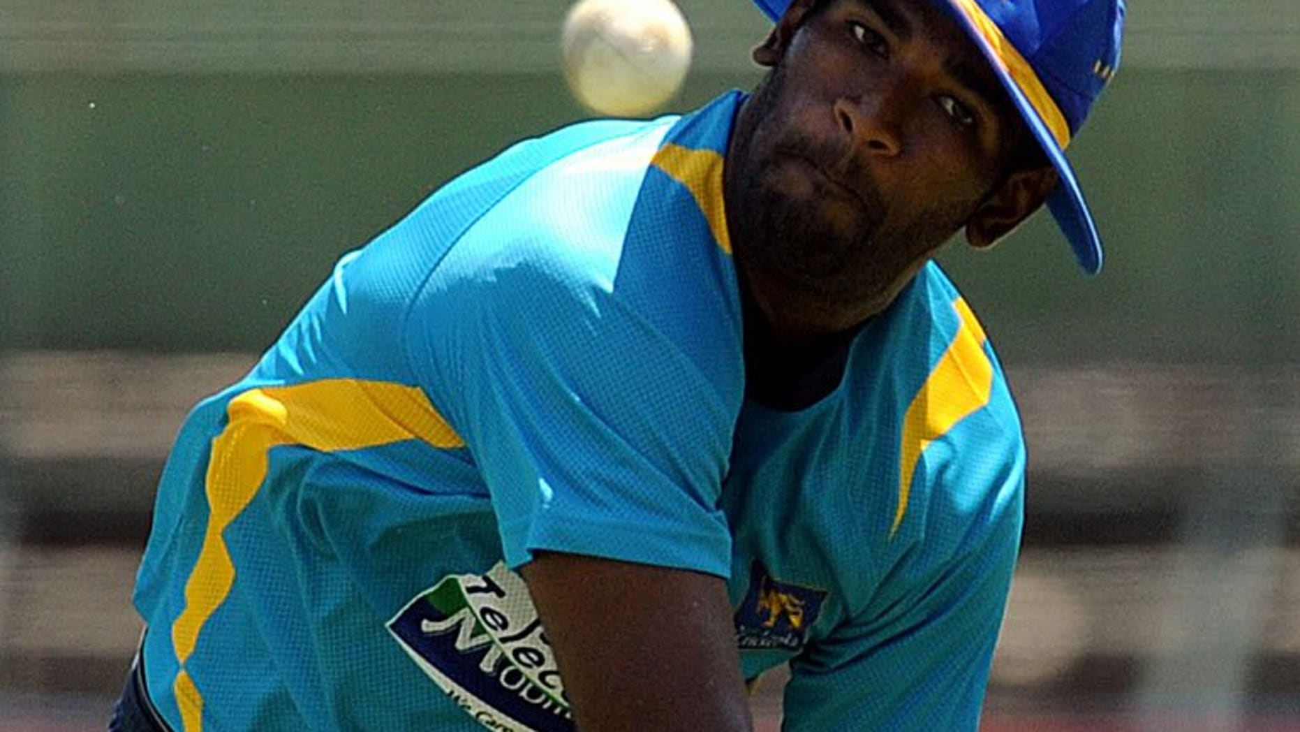 Sri Lankan cricketer Ramith Rambukwella throws a ball during a practice session in Pallekele, on March 30, 2013. Sri Lankan cricket chiefs handed down a fine of nearly $2,000 to Rambukwella after the batsman tried to force open a cabin door of a British Airways flight at 35,000 feet (10,600 metres).