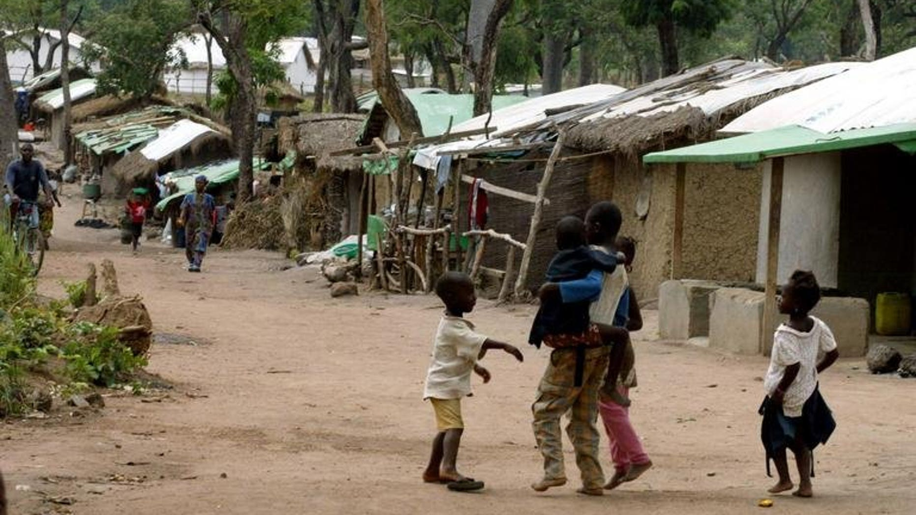 A Kuntaya refugee camp on May 5, 2002, some 760 kilometres southeast of Conakry. Volunteers continued the grim task of collecting bodies from the streets in southern Guinea on Thursday after ethnic clashes which left dozens burned alive or hacked to death with machetes.