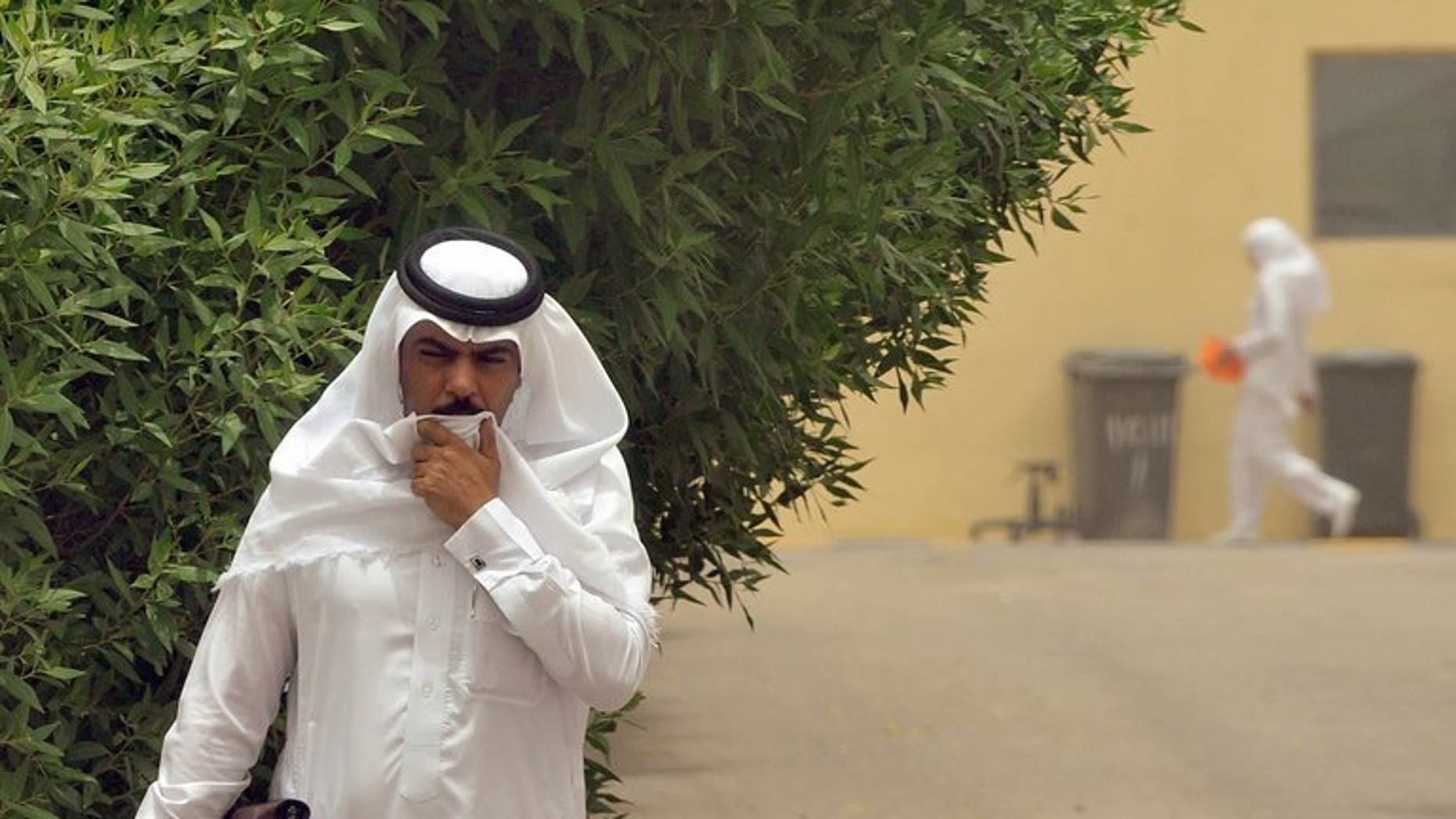 A Saudi man walks toward the King Fahad hospital in the city of Hofuf, east of the Saudi capital Riyadh on June 16, 2013. Six more people, most of them health care workers, have contracted the deadly MERS virus in Saudi Arabia and the United Arab Emirates, the World Health Organization said Thursday.