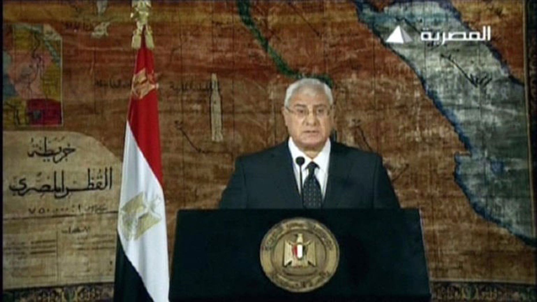 "An image grab taken from Egyptian state TV shows Egypt's interim president Adly Mansour delivering his first televised address to the nation since his inauguration, on July 18, 2013 in Cairo. Mansour vowed on Thursday to battle for security ""to the end"", as Islamists promised new protests against his army-installed interim government."