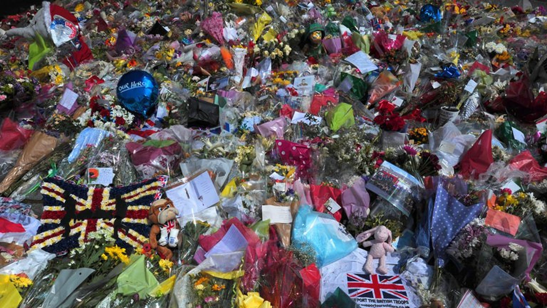Floral tributes are seen at the scene of the murder of Lee Rigby outside Woolwich Barracks on May 31, 2013. Police are investigating claims that one of the two chief suspects in a brutal suspected Islamist attack, against a British soldier on a London street, was assaulted in prison.