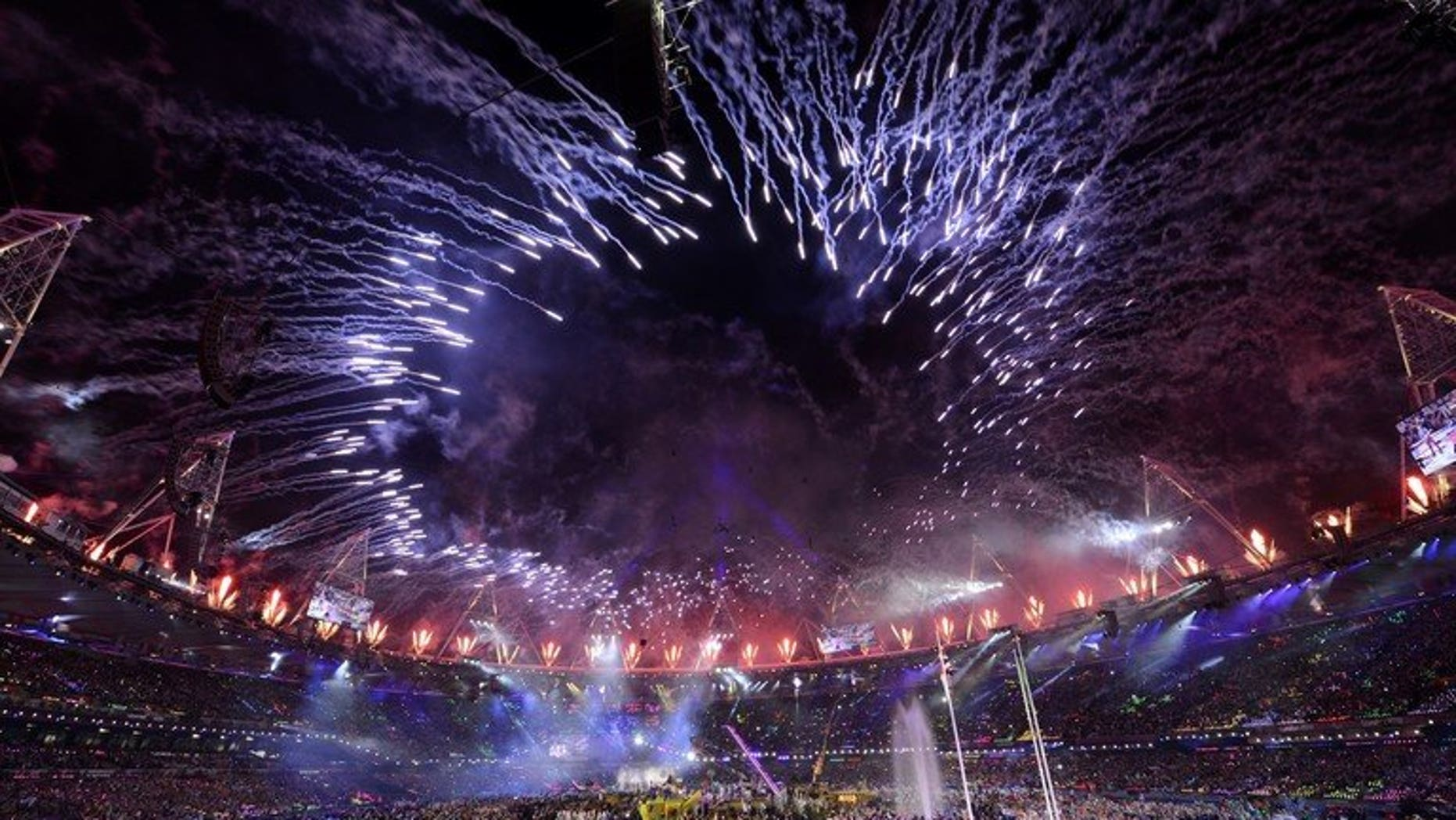 Fireworks light up the sky above the Olympic Stadium during the closing ceremony of the London 2012 Paralympic Games, on September 9, 2012. The Olympic Games in London last year gave the British economy a boost worth $15 billion, the government said on Friday, a figure far higher than the cost of staging the event.