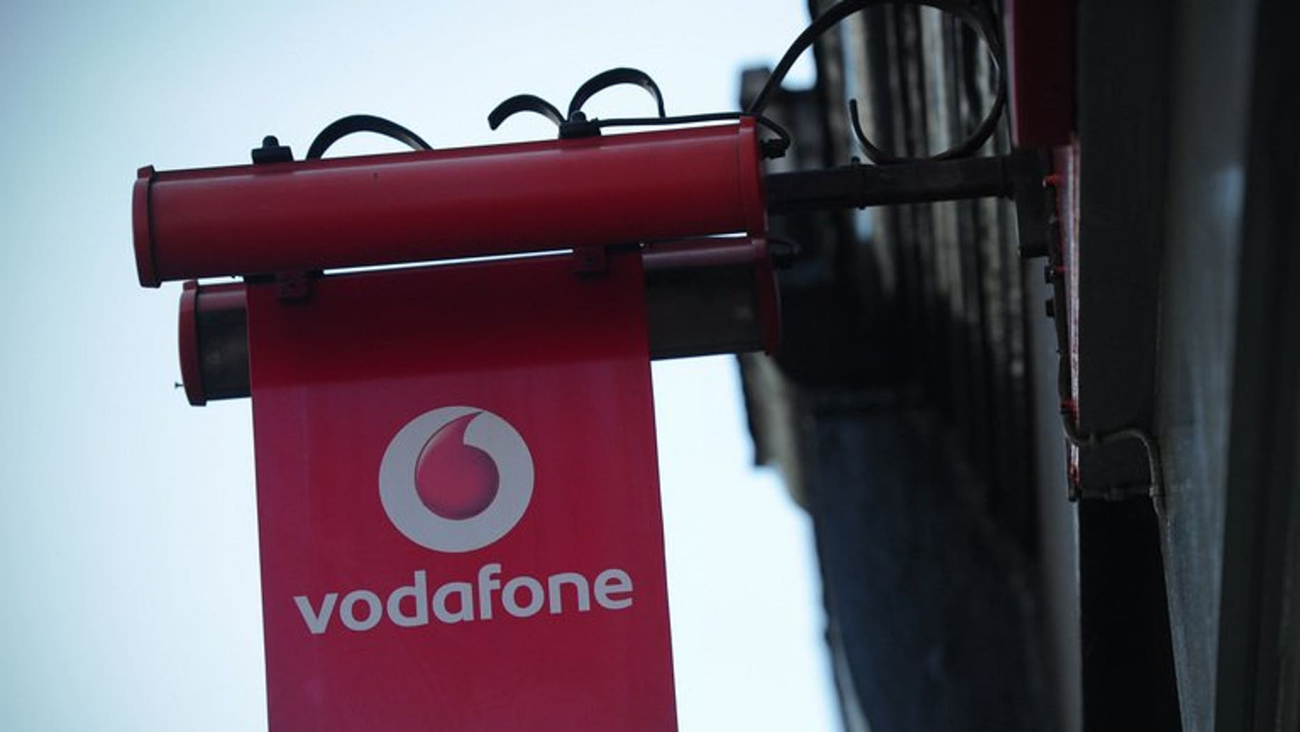 A sign outside a Vodafone shop in London. British mobile phone giant Vodafone said on Friday that sales grew in the first quarter, as strength in emerging markets countered weakness in Europe.