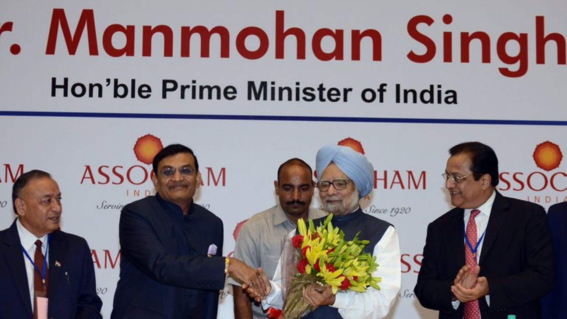 """Manmohan Singh (centre right) at a meeting of industry leaders in New Delhi on Friday. India's Prime Minister urged investors to """"remain optimistic"""", while acknowledging growth in 2013-14 is likely to fall short of the government's 6.5% target."""