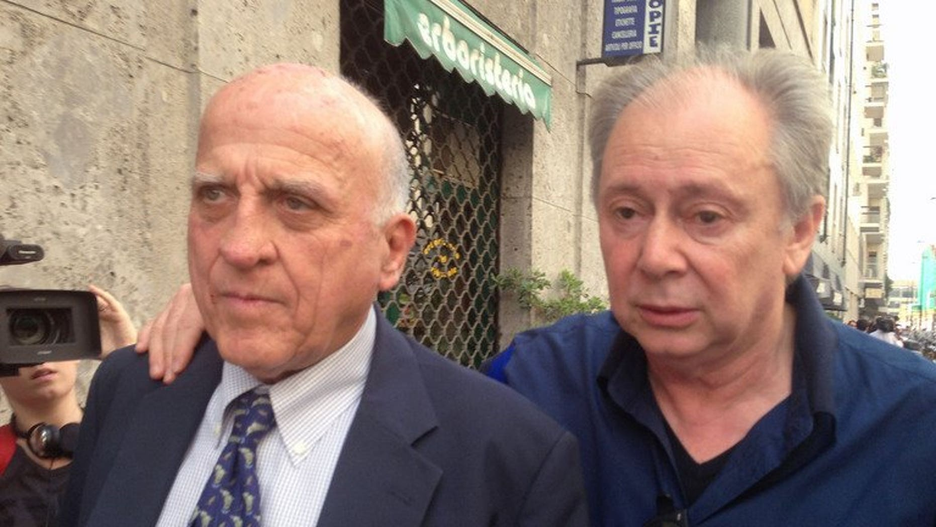 Italian entertainment agent Lele Mora (right) and his lawyer Gianluca Maris arrive at a court in Milan on July 19, 2013. A Milan court on Friday found three of Silvio Berlusconi's associates guilty of procuring prostitutes for racy parties held at the former Italian premier's Milan villa.