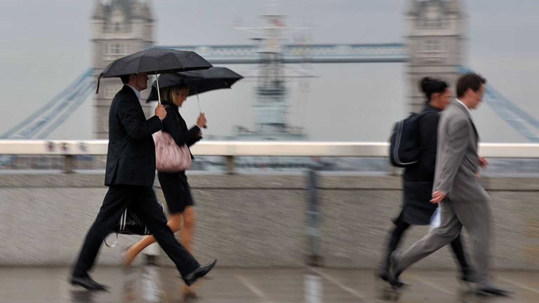 City workers walk over London Bridge. London shares closed steady on Friday, retaining the week's gains, as market heavyweight Vodafone rose after unveiling higher sales for its latest quarter.