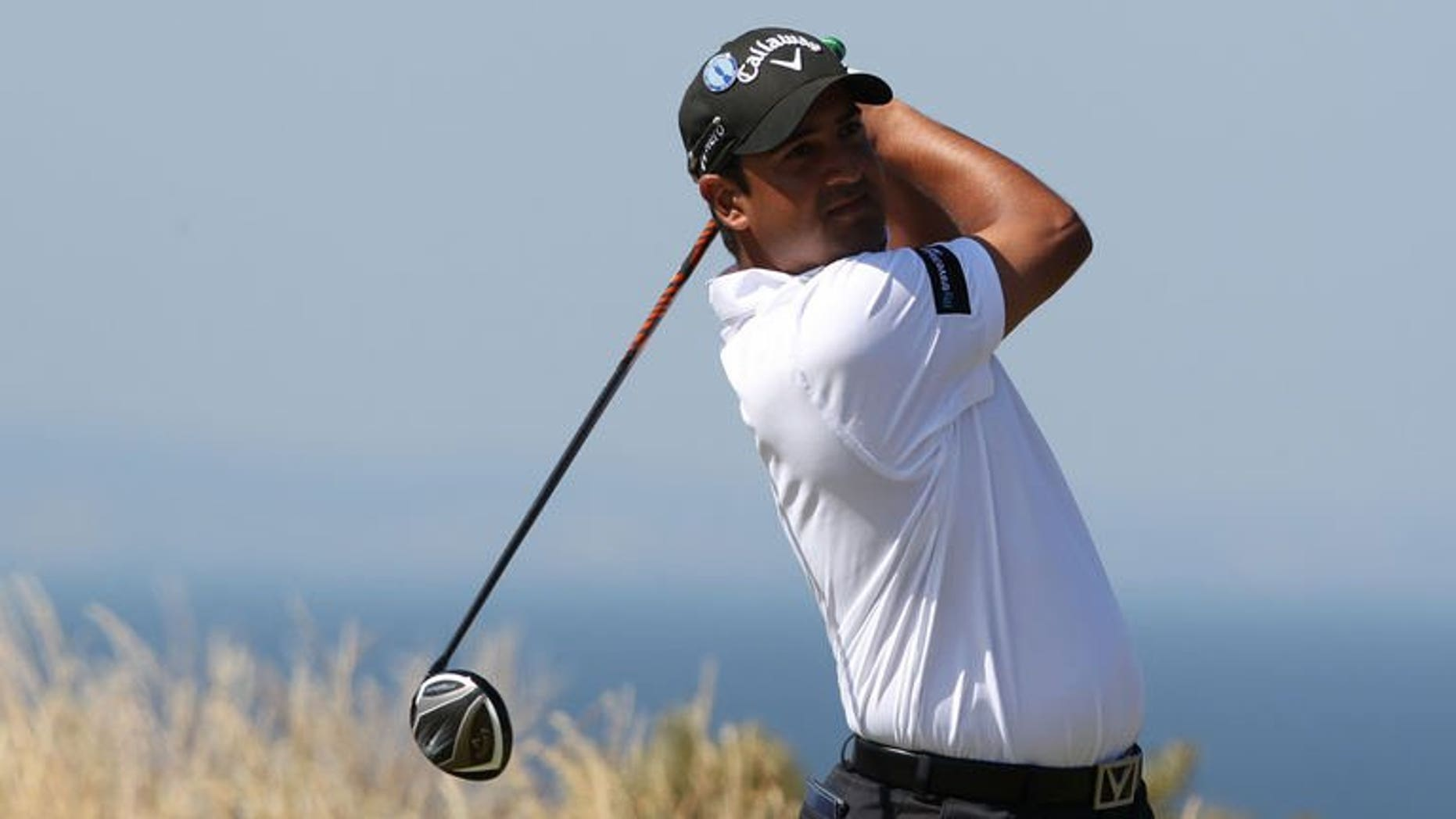 India's Shiv Kapur tees off on the fifth during the second round of the 2013 British Open Golf Championship at Muirfield golf course at Gullane in Scotland on July 19, 2013. Kapur of India will aim to recreate his opening day magic after shooting a six-over-par 77 at the halfway stage of the British Open on Friday.