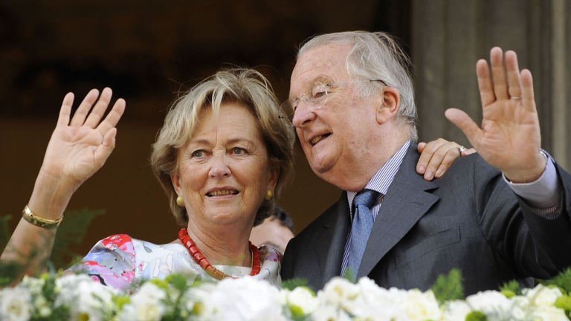 King Albert II of Belgium and Queen Paola wave to the crowd on July 19, 2013 during a visit in Eupen in Liege. The visit to the southern Belgian city was Albert's last in 20 years of a reign that comes to a close Sunday.