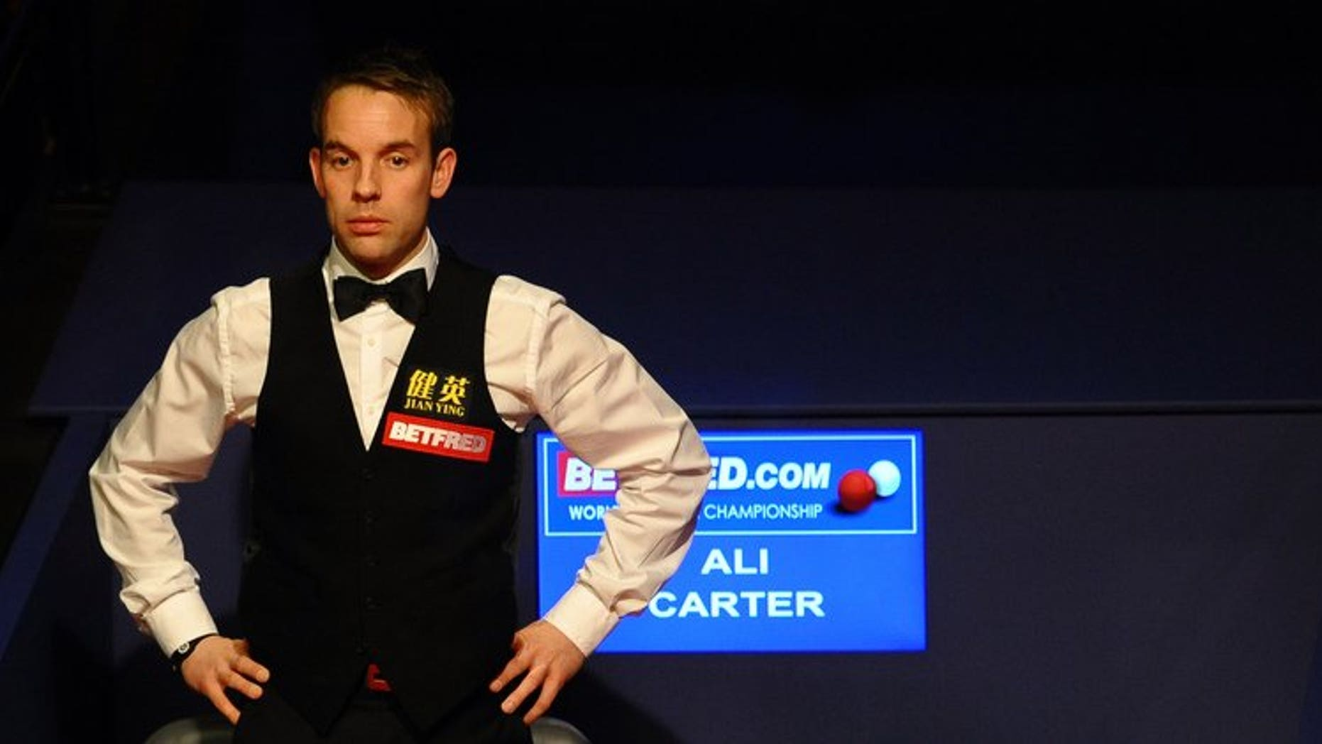 Ali Carter of England watches on May 7, 2012 during the third session of the World Championship Snooker final at the Crucible Theater in Sheffield, England. Carter will return to action at the Shanghai Masters after being given the all-clear from testicular cancer.
