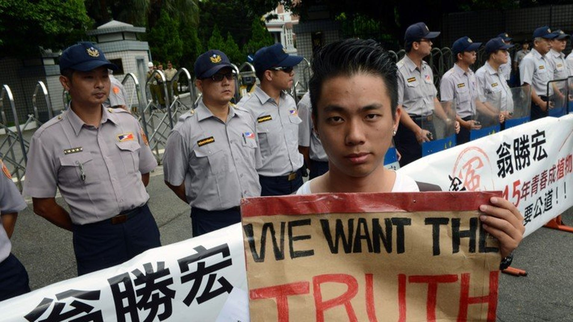 A protester during an anti-military rally outside the defence ministry in Taipei on July 20, 2013. Thousands of protesters demanded justice for a corporal who died after allegedly being abused in the military, in a case that sparked anger across Taiwan.