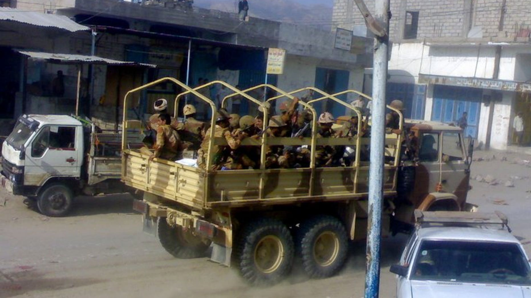 Yemeni troops patrol the town of Mudia in Abyan province, on October 17, 2010. Al-Qaeda suspects have shot dead a member of a pro-army militia that had backed a military offensive against the network in 2012, a police official tells AFP.