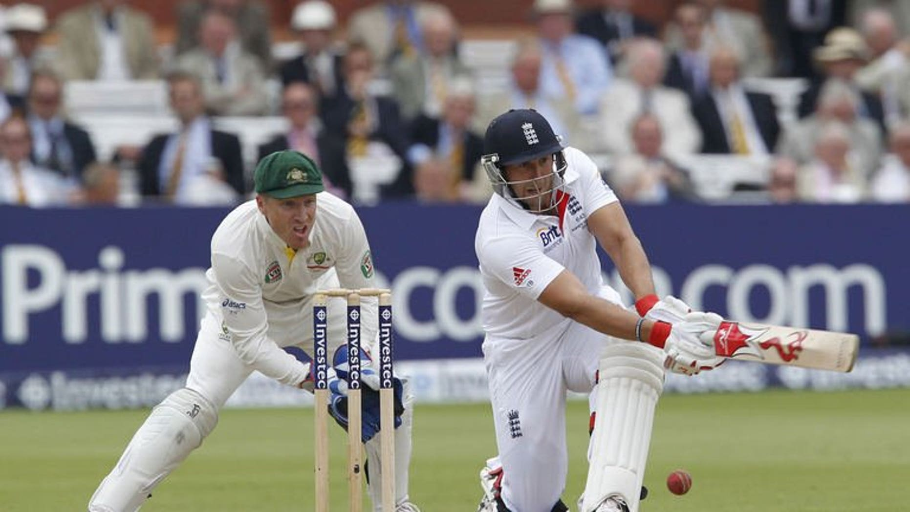 England's Tim Bresnan (right) plays a shot watched by Australia's wicketkeeper Brad Haddin during the third day of the second Ashes Test at Lord's in London, on July 20, 2013. England were 114 for three in their second innings, a lead of 347 runs, at lunch.