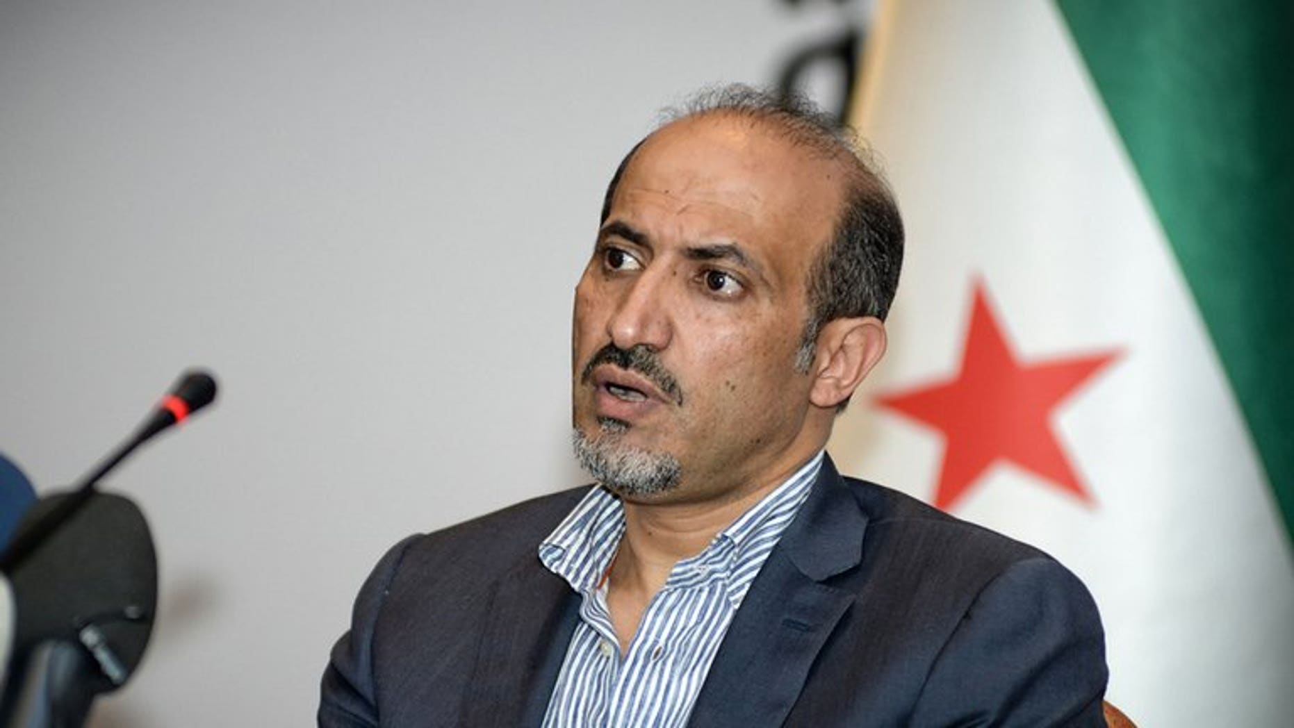A handout photo taken and provided on July 9, 2013 shows Syrian National Coalition (SNC) leader Ahmad al-Assi attending a meeting in Istanbul. Jarba has set his priority on securing arms for rebels fighting regime troops since 2011.