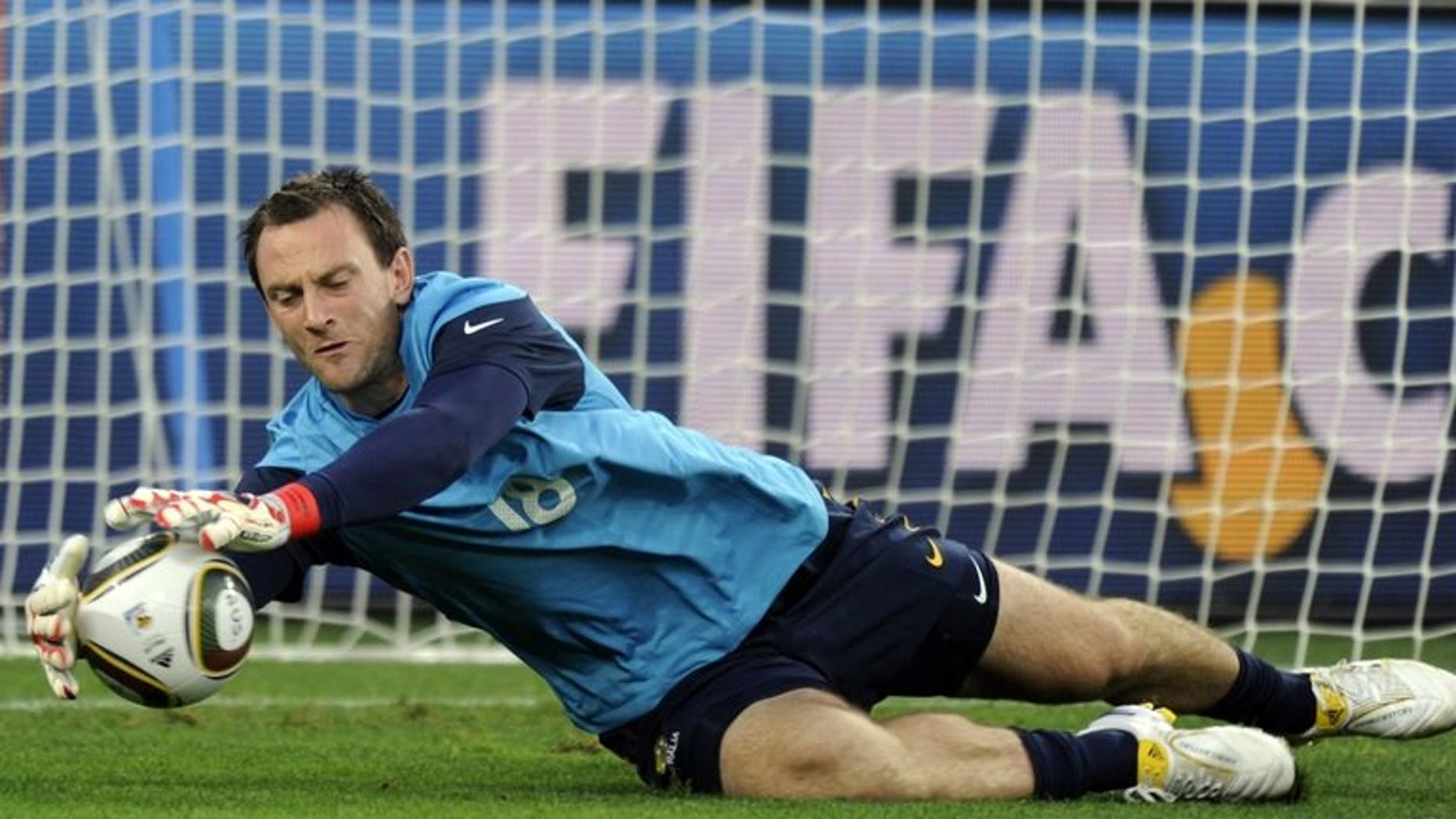 Australia's goalkeeper Eugene Galekovic stops a ball during an official training session in Durban on June 12, 2010. Host South Korea wasted a slew of goal chances as they played Australia to a scoreless draw at the East Asian Cup match here on Saturday.