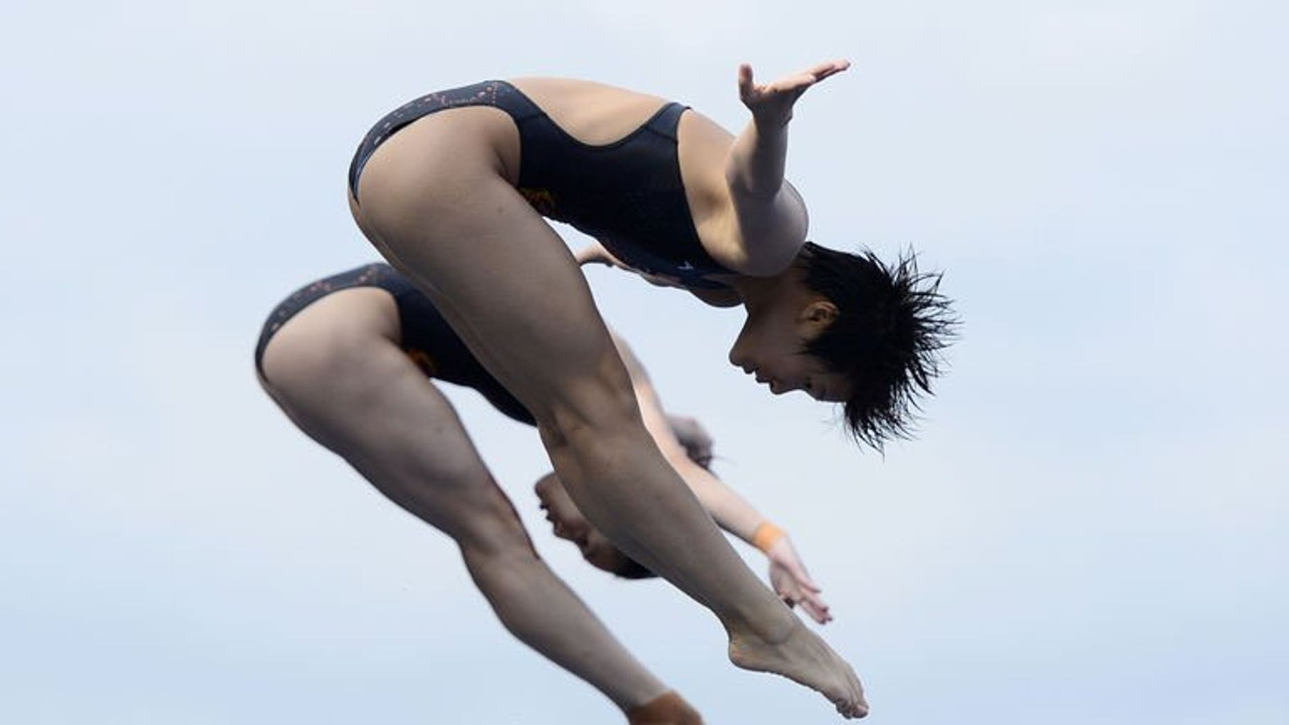 China's Shi Tingmao and Wu Minxia compete in the women's 3-metre synchro springboard final diving event in the FINA World Championships at the Piscina Municipal de Montjuic in Barcelona on July 20, 2013. Shi and Wu won gold.