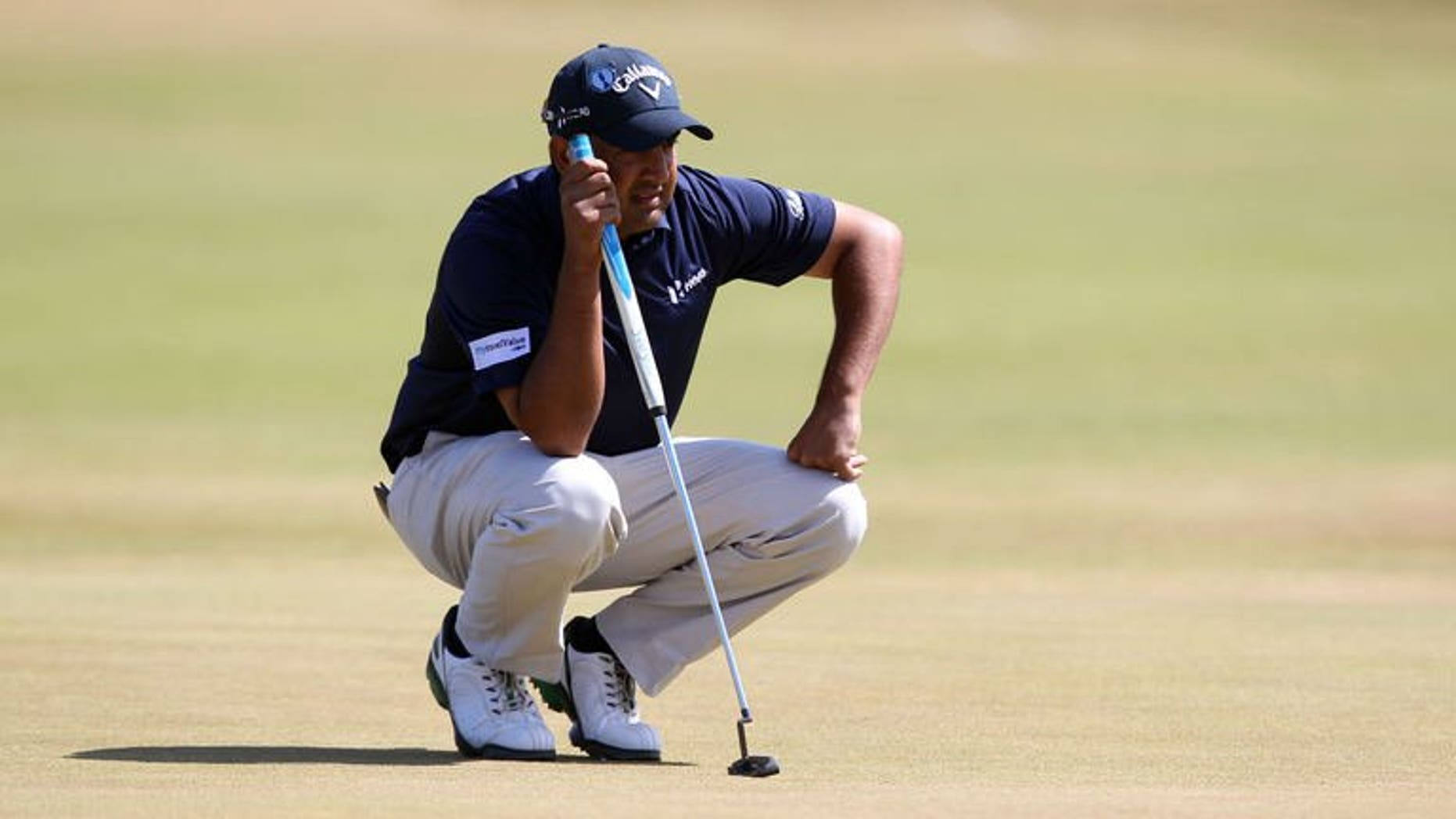 India's Shiv Kapur lines up a putt on the first green during the third round of the 2013 British Open Golf Championship at Muirfield golf course at Gullane in Scotland on July 20, 2013.