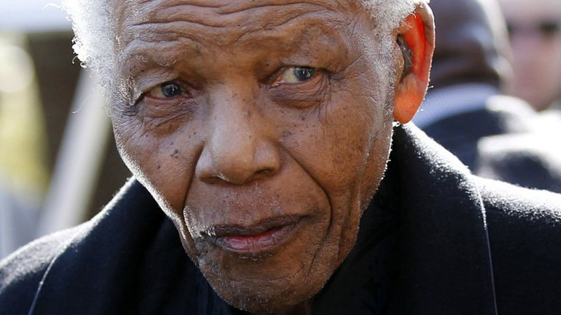 A picture taken on June 17, 2010 shows global icon Nelson Mandela arriving for a funeral, just north of Johannesburg. Mandela who celebrated his 95th birthday this week remained in hospital on Saturday, six weeks after he was admitted for treatment for a lung illness.