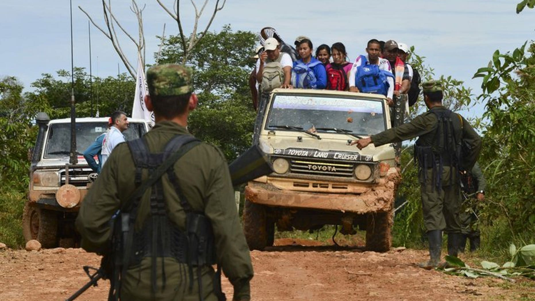 Revolutionary Armed Forces of Colombia (FARC) rebels set up a check-point near San Isidro, Caqueta, on May 30, 2012. Six guerrillas from the leftist FARC rebel group and four Colombian soldiers have been killed in clashes in southwest Colombia, the military said.