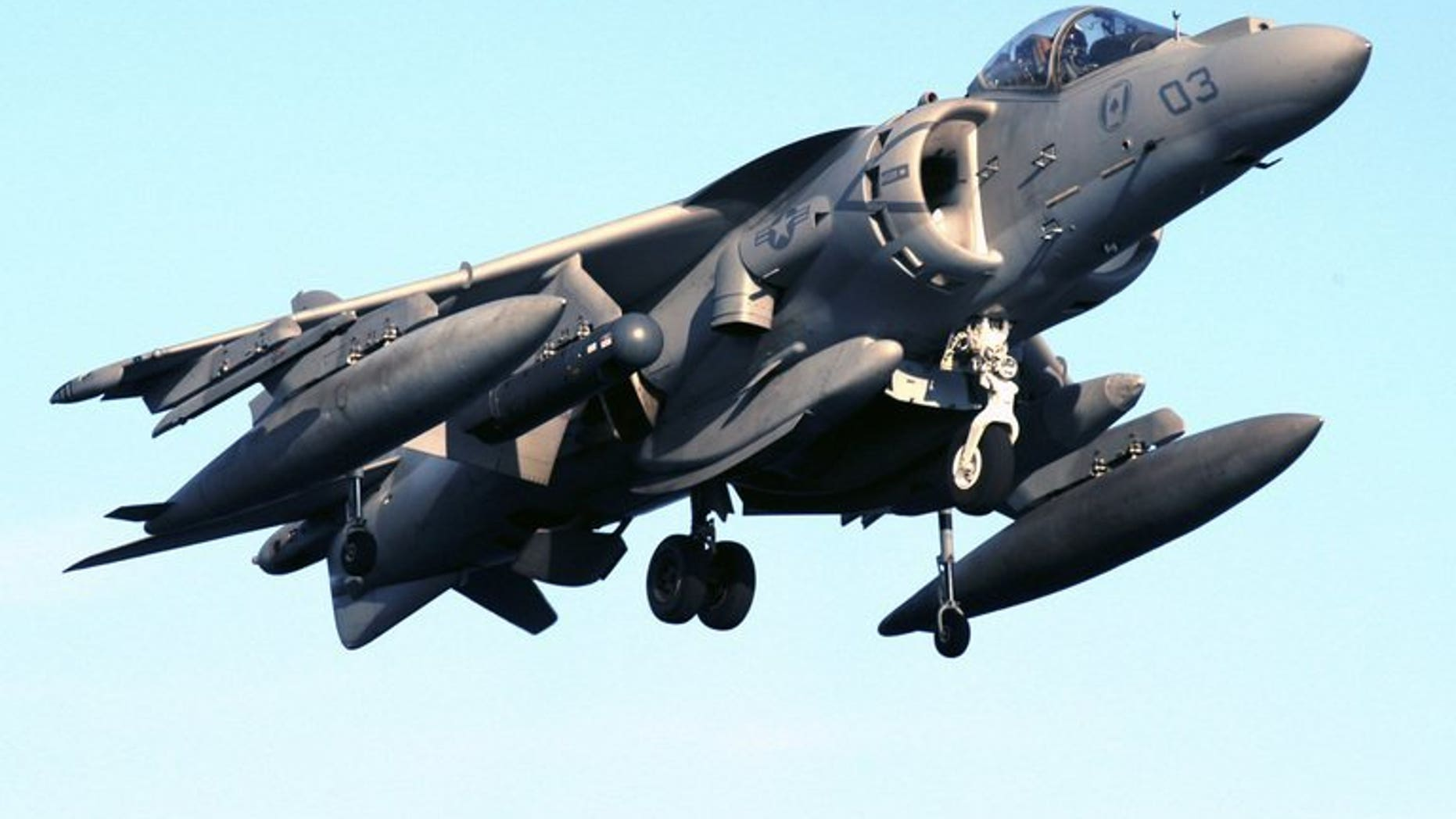 """This file photo, released by US Navy, shows an AV-8B Harrier jet preparing to land on the flight deck of an amphibious assault ship. Similar jets dropped four unarmed bombs on Australia's Great Barrier Reef on July 16, 2013, in an """"emergency jettison"""" during a training exercise, officials said, ruling out any risk to the public or environment."""