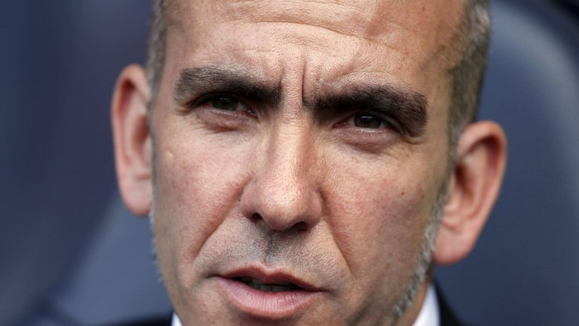 Sunderland's Italian manager Paolo Di Canio is seen at his team's match in London on May 19, 2013. Di Canio has joked he would have to cough up the cash to his players after threatening to fine them if they returned for pre-season overweight.