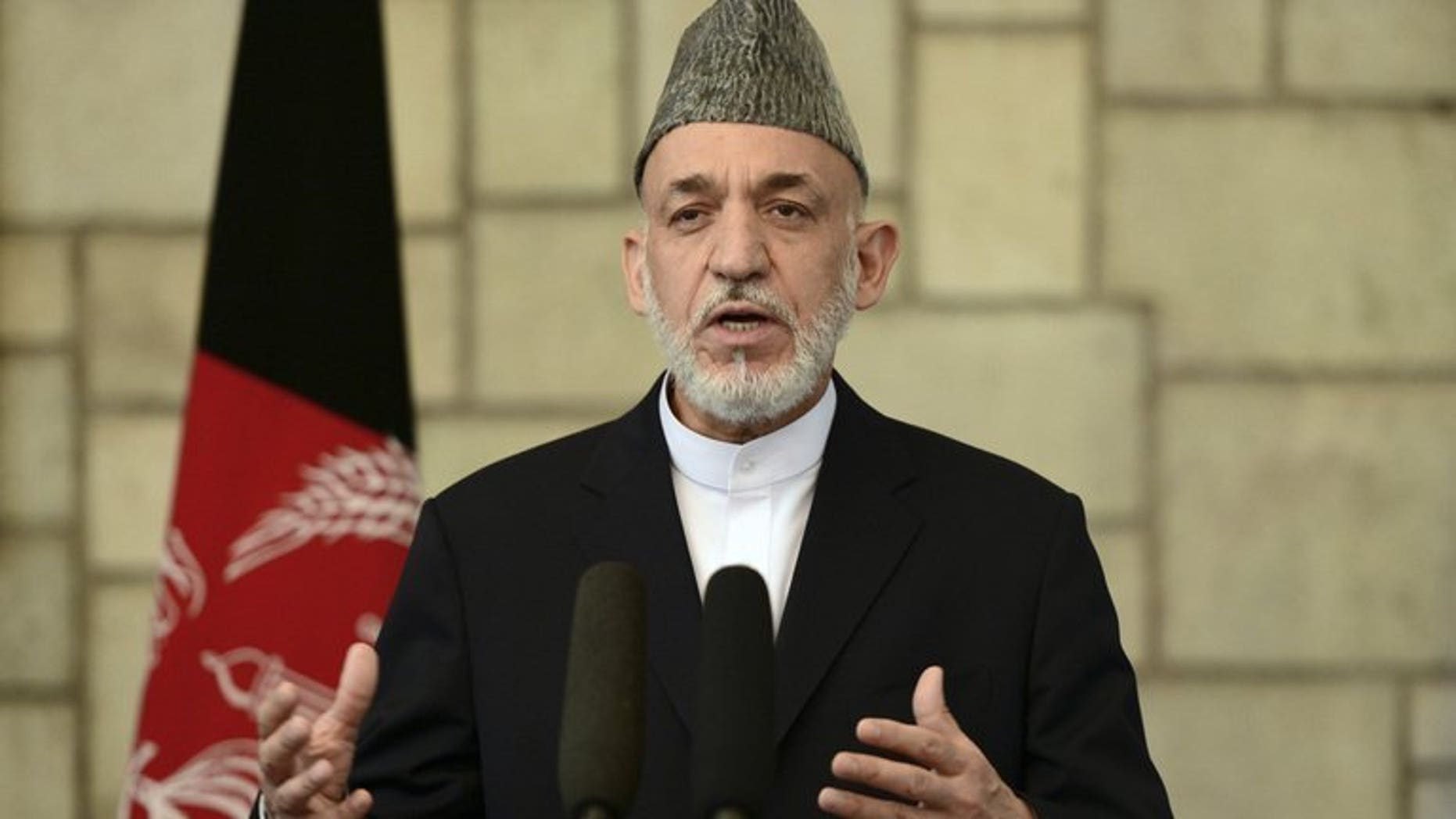 Afghan President Hamid Karzai speaks at a press conference in Kabul, on June 29, 2013. A senior Pakistani official has flown to Kabul, inviting Karzai to Islamabad as part of a charm offensive designed to improve strained relations and help peace efforts with the Taliban.