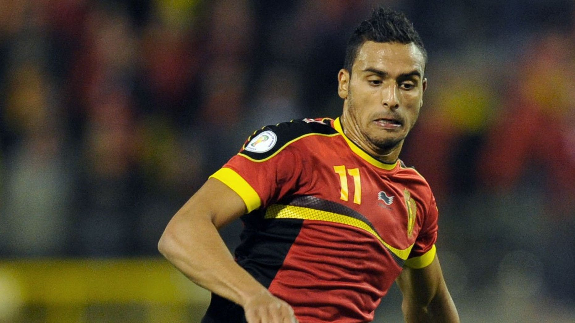 Belgium national football team's Nacer Chadli runs with the ball during the 2014 World Cup qualifying football match in Brussels on October 16, 2012. Tottenham are set to sign the FC Twente winger after agreeing a fee for the Belgian international.