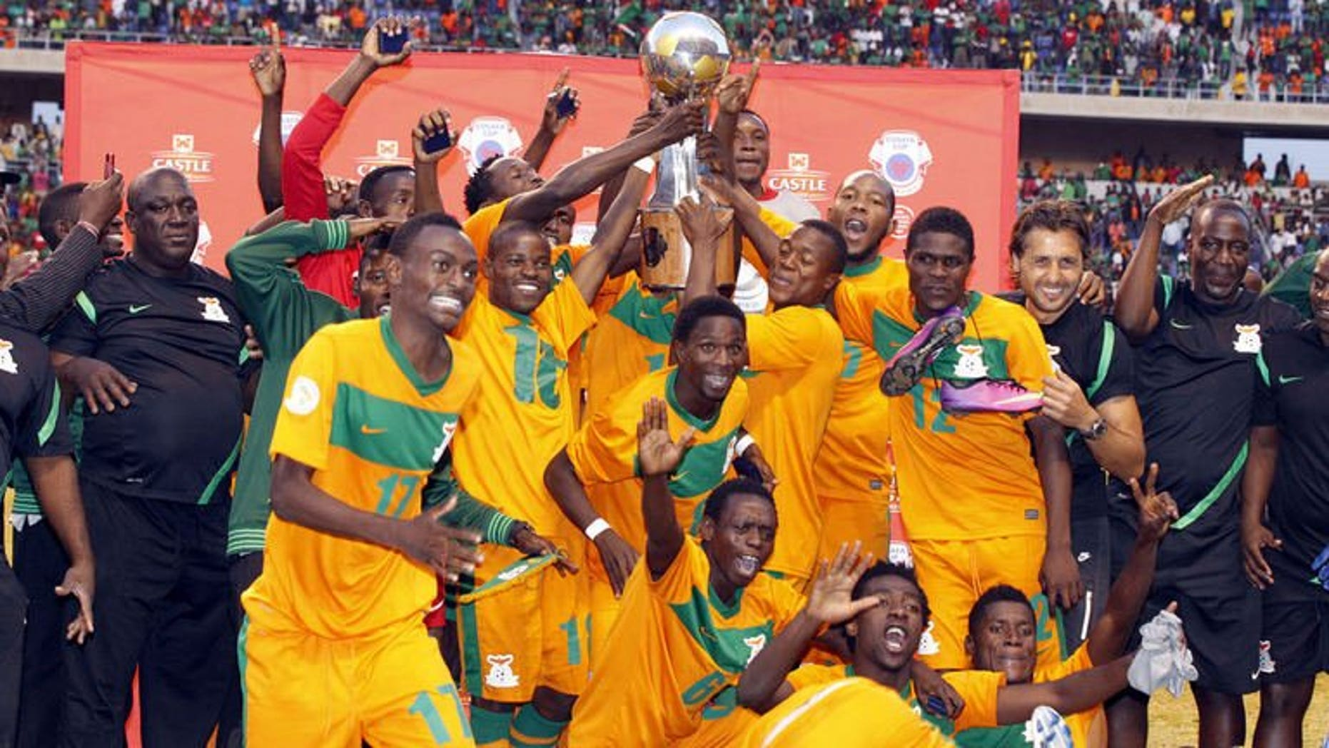 Zambia's players celebrate after beating Zimbabwe during their COSAFA tournament final match in Ndola, on July 20, 2013. Coach Herve Renard has admitted that hosts Zambia were lucky to defeat Zimbabwe.
