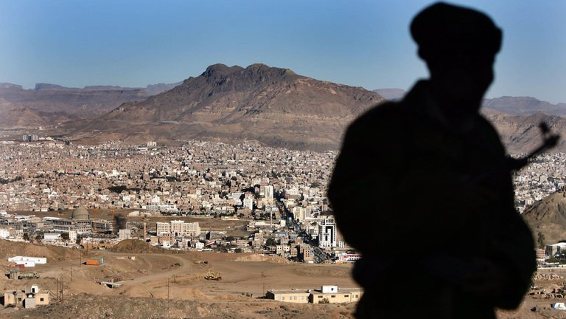 A Yemeni soldier stands on a hill overlooking Sanna, on January 13, 2010. Unknown gunmen have kidnapped an Iranian embassy employee in the Yemeni capital Sanaa, police said, an abduction confirmed by the foreign ministry in Tehran.