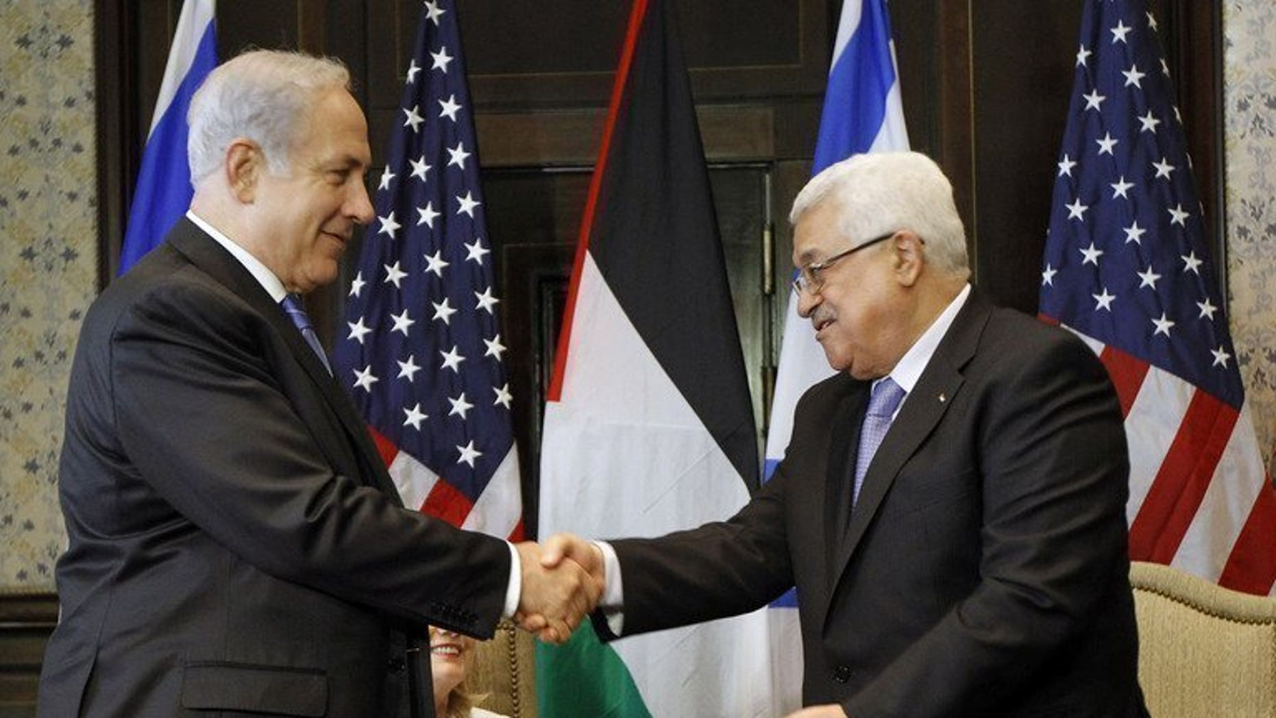 Israeli Prime Minister Benjamin Netanyahu (left) shakes hands with Palestinian president Mahmud Abbas during talks in Sharm El-Sheikh, on September 14, 2010. Iran has voiced opposition to a US-mediated resumption of peace talks between Israel and the Palestinians, predicting the Jewish state would never agree to withdraw from occupied Arab lands.