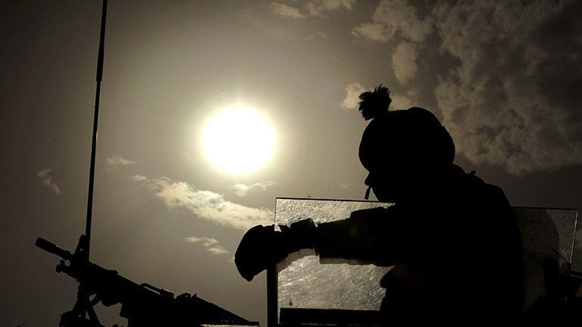 A British soldier keeps watch during a patrol on the outskirts of Kabul, on July 27, 2008. A UN demining group has warned that unexploded ordnance left behind by NATO troops is killing and injuring a rising number of Afghan civilians.