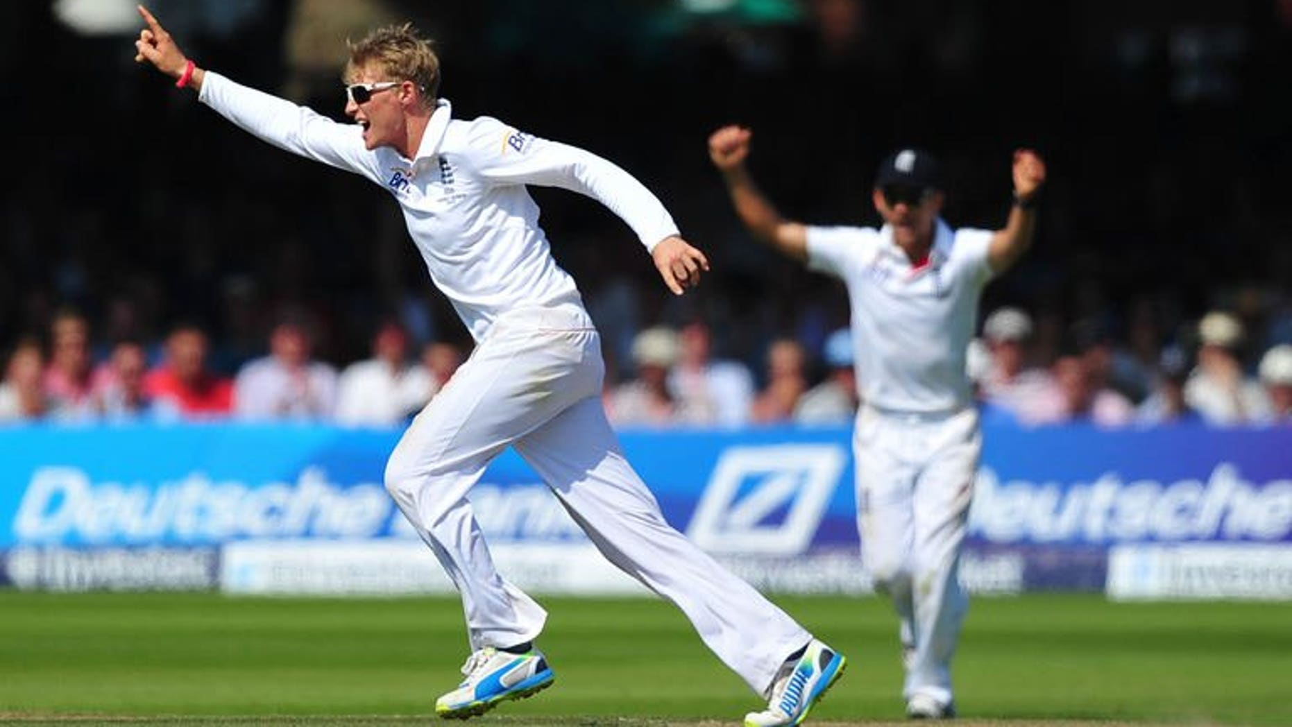 England's Joe Root (left) celebrates after taking the wicket of Australia's Usman Khawaja on the fourth day of the second Ashes Test against Australia at Lord's on July 21, 2013. Root captured two wickets, including the prize scalp of Australia captain Michael Clarke, after making a dominating 180 as England eyed a 2-0 Ashes series lead.