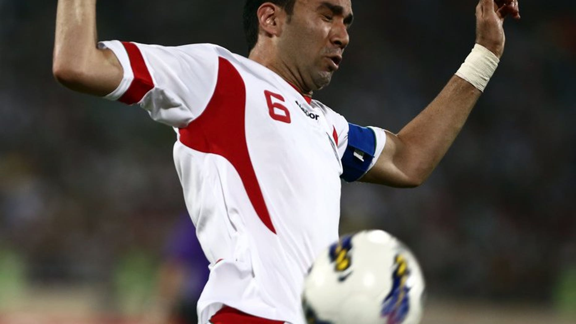 Iran's Javad Nekounam controls the ball during their 2014 World Cup qualifying match against Lebanon in Tehran, on June 11, 2013. Iran has barred Nekounam's lucrative transfer to a club in neighbouring UAE because of a dispute over a name, media reports said on Sunday.