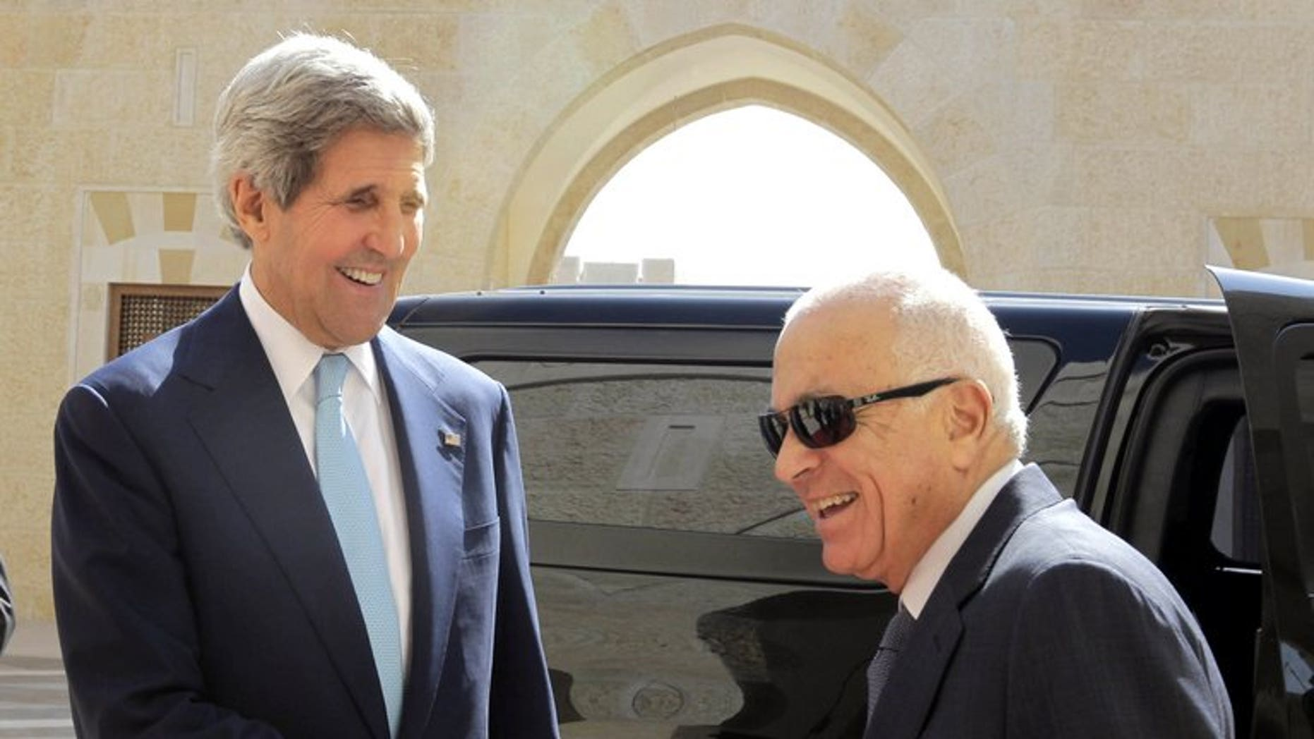 US Secretary of State John Kerry (left) shakes hands with Arab League chief Nabil el-Araby ahead of talks at the Hummar Palace in Amman, on July 17, 2013. The Arab League says it supports the Palestinian stance on the announcement of resumed peace talks with Israel, but that it was sceptical of Israeli intentions.